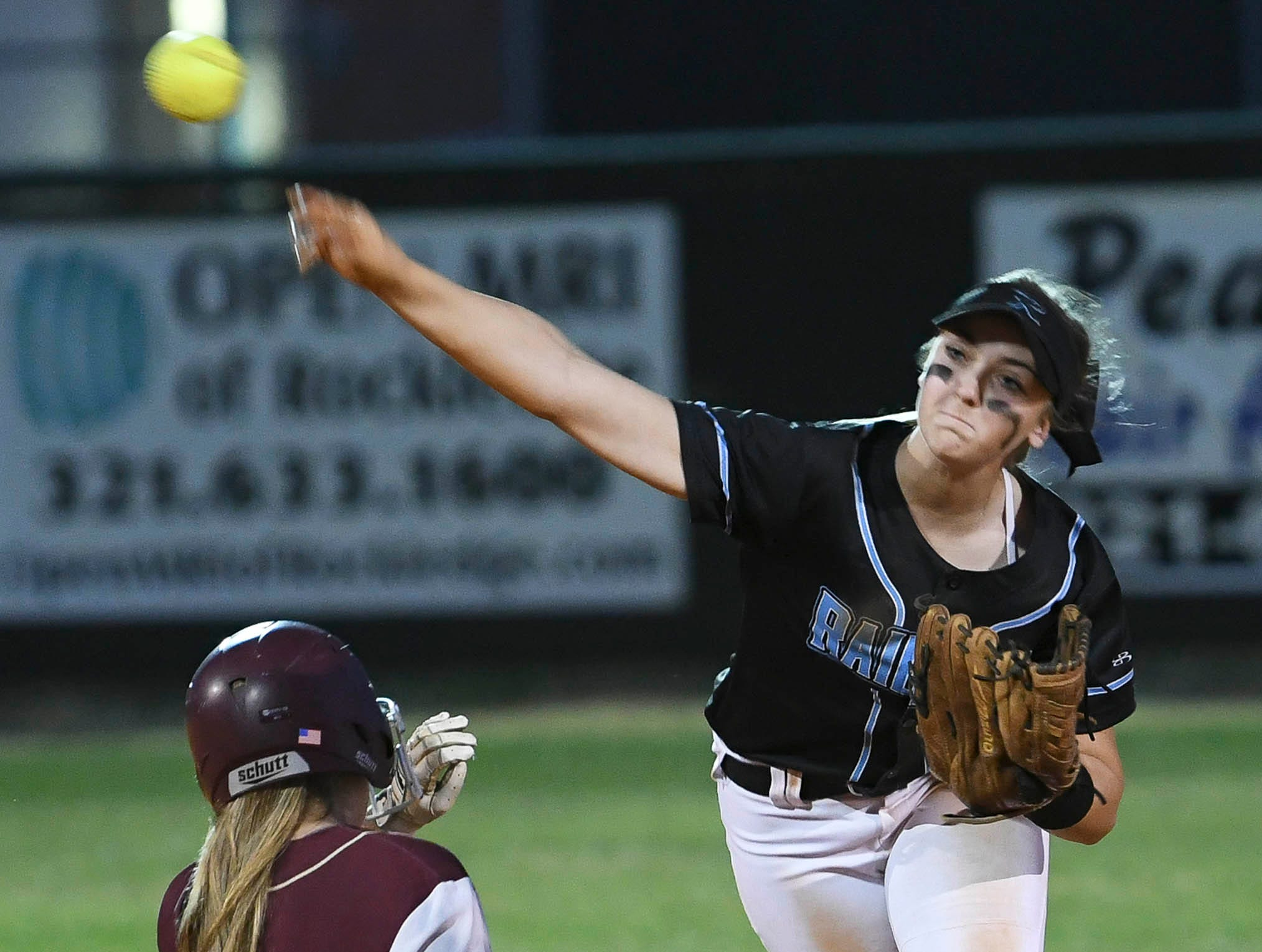 Emily Thomas of Rockledge turns a double play during Wednesday's game against Astronaut.