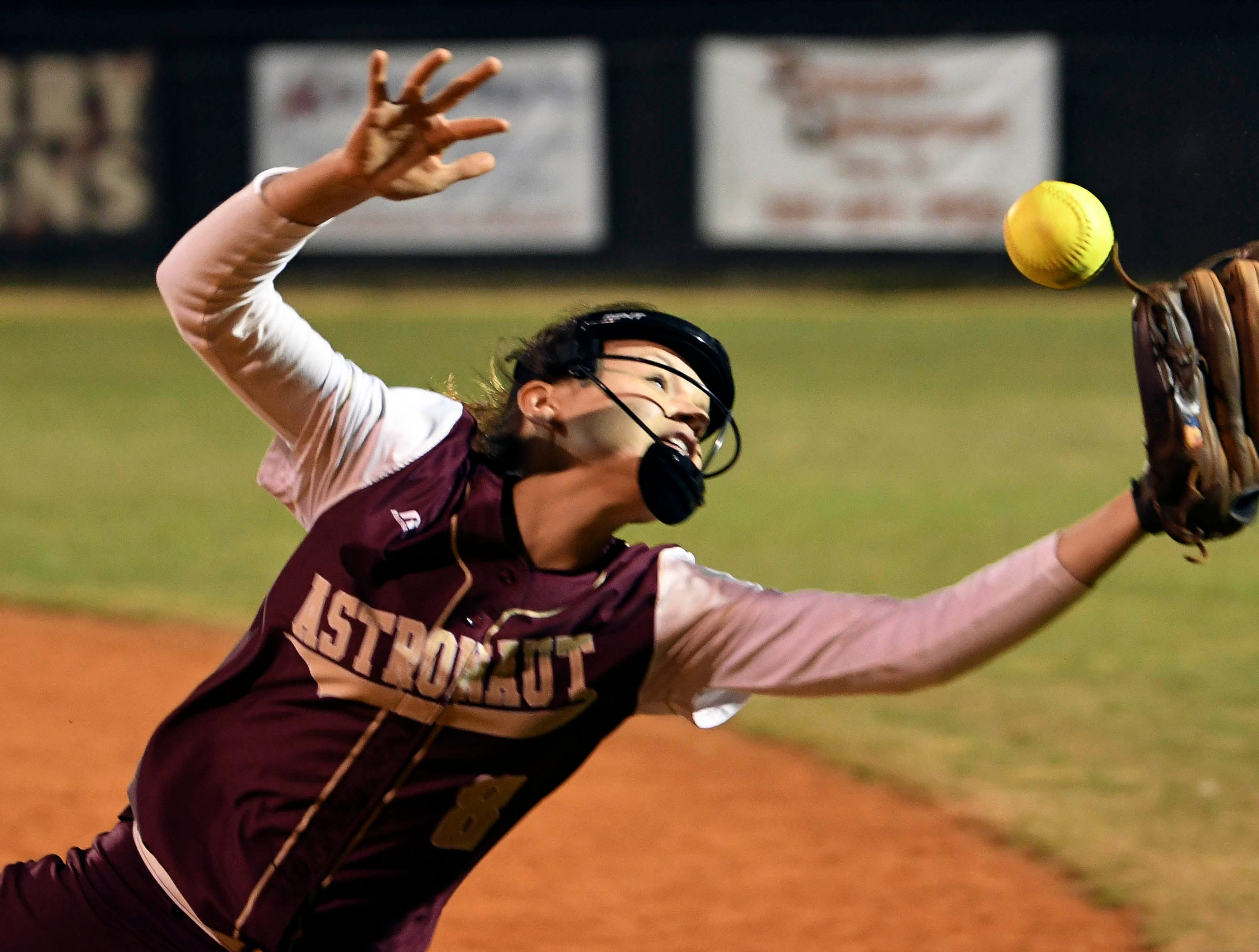 J. Lenders of Astronaut dives for a ball just out of reach during Wednesday's game in Rockledge