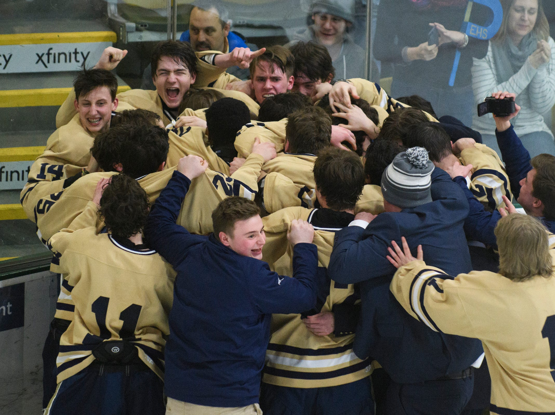 Essex celebrates the championship during the DI boys hockey championship game between the Rice Green Knights and the Essex Hornets at Gutterson Field House on Wednesday night March 13, 2019 in Burlington, Vermont.