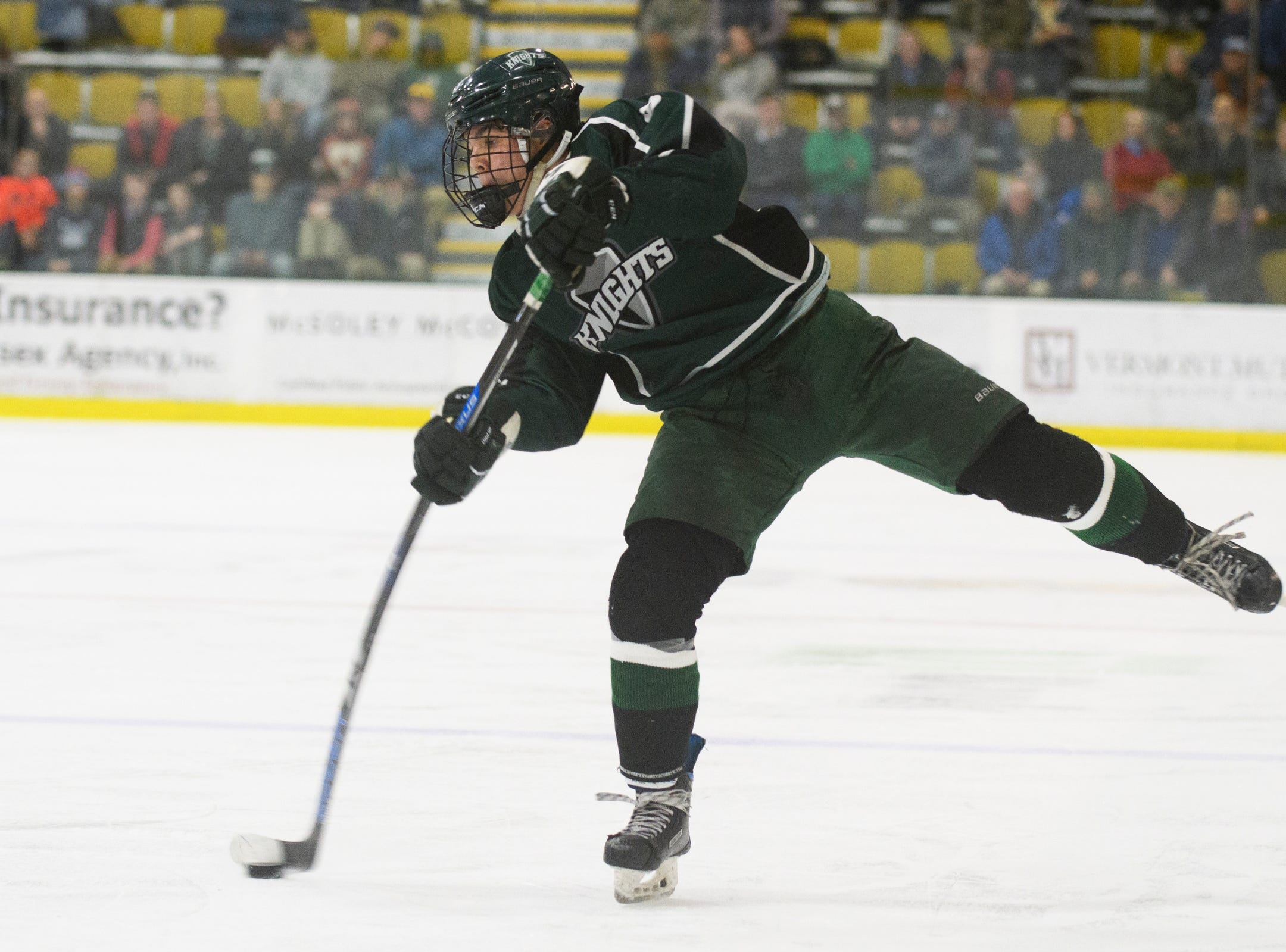 Rice's Cameron Kinsell (8) shoots the puck during the DI boys hockey championship game between the Rice Green Knights and the Essex Hornets at Gutterson Field House on Wednesday night March 13, 2019 in Burlington, Vermont.