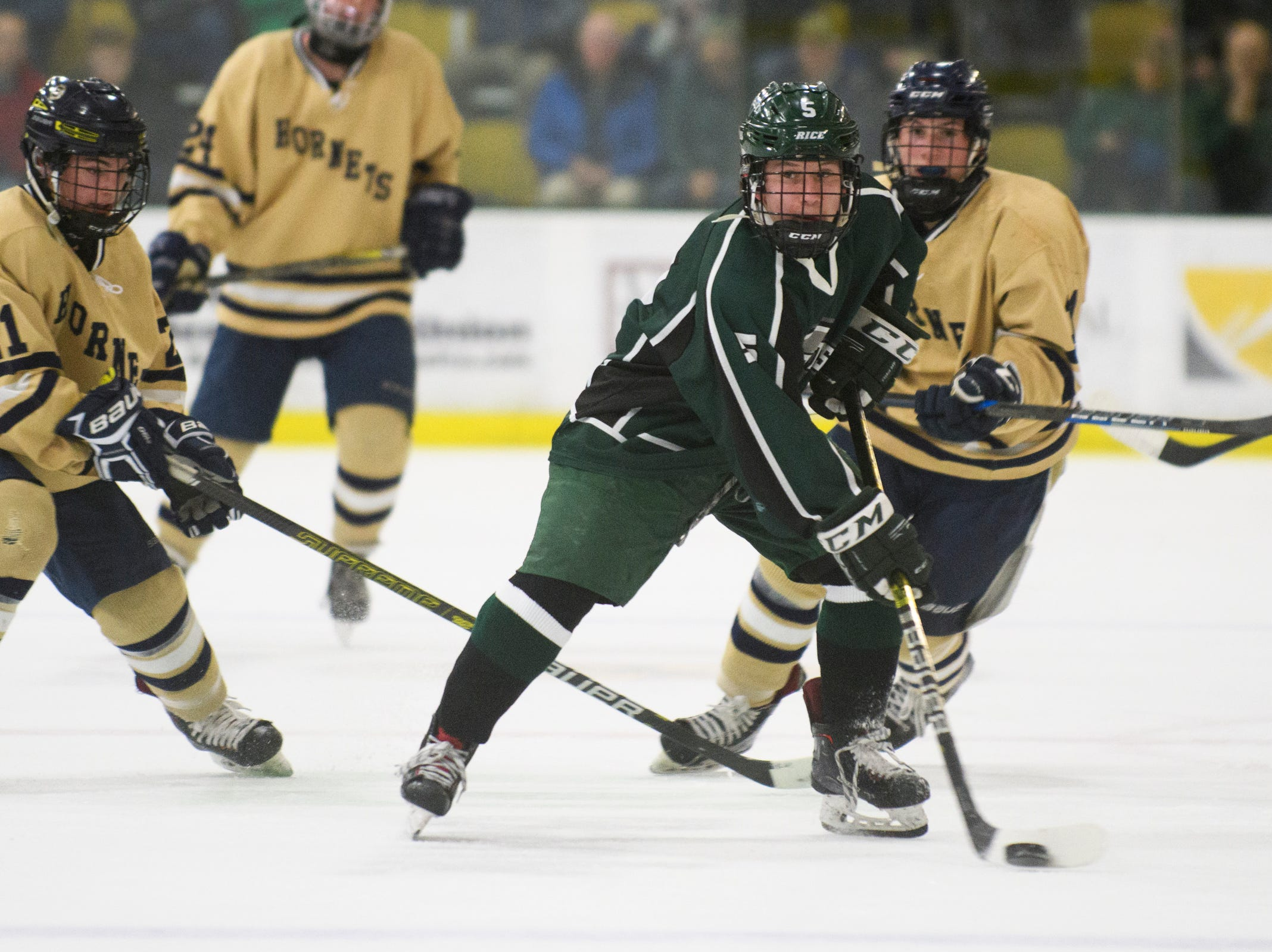 Rice's Connor Peet (5) skates with the puck during the DI boys hockey championship game between the Rice Green Knights and the Essex Hornets at Gutterson Field House on Wednesday night March 13, 2019 in Burlington, Vermont.