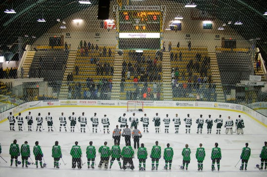 The teams listen to the National Anthem during the DII boys hockey championship game between the Woodstock Wasps and the Colchester Lakers at Gutterson Field House on Wednesday night March 13, 2019 in Burlington, Vermont.