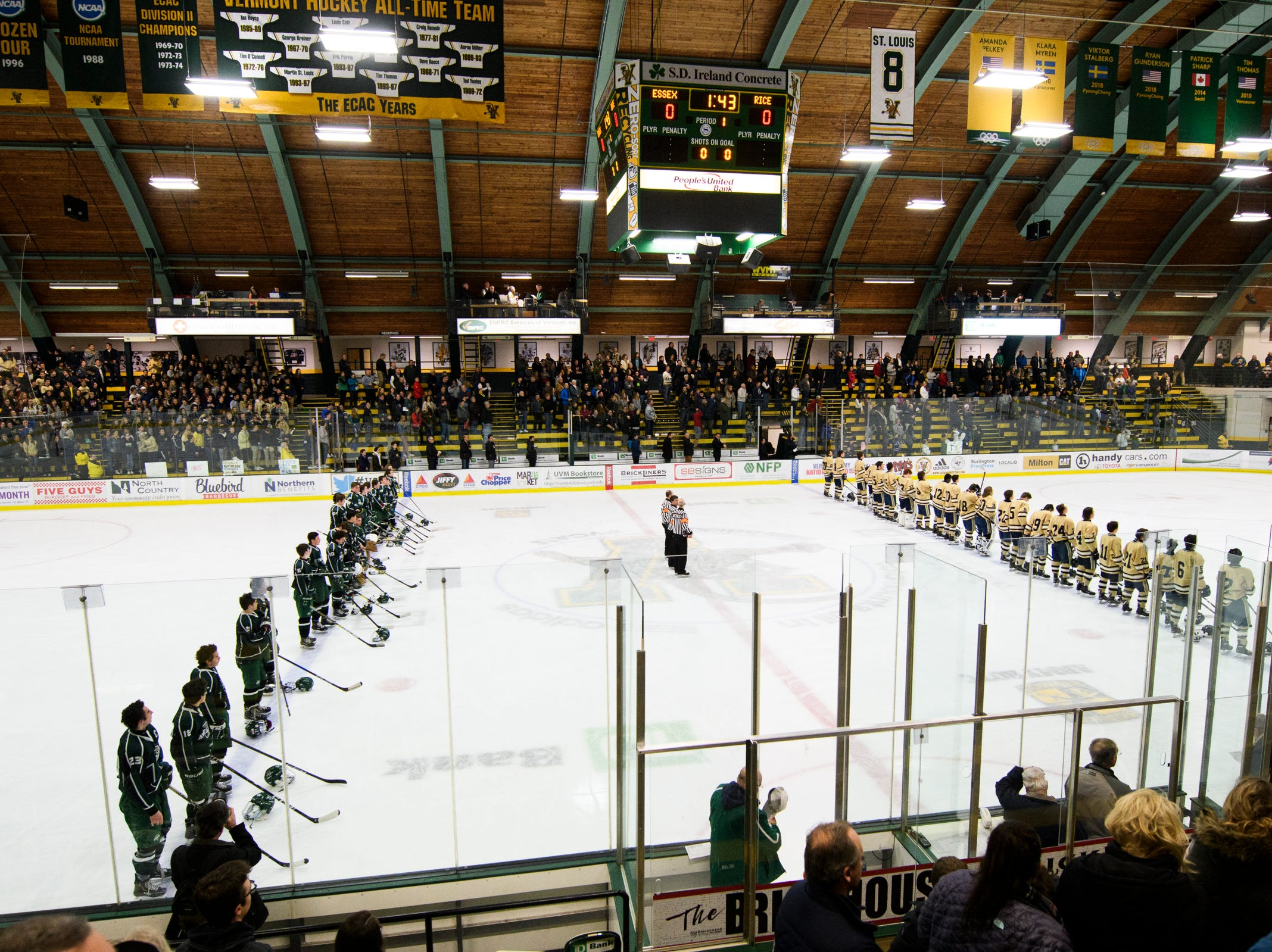 The teams listen to the National Anthem during the DI boys hockey championship game between the Rice Green Knights and the Essex Hornets at Gutterson Field House on Wednesday night March 13, 2019 in Burlington, Vermont.