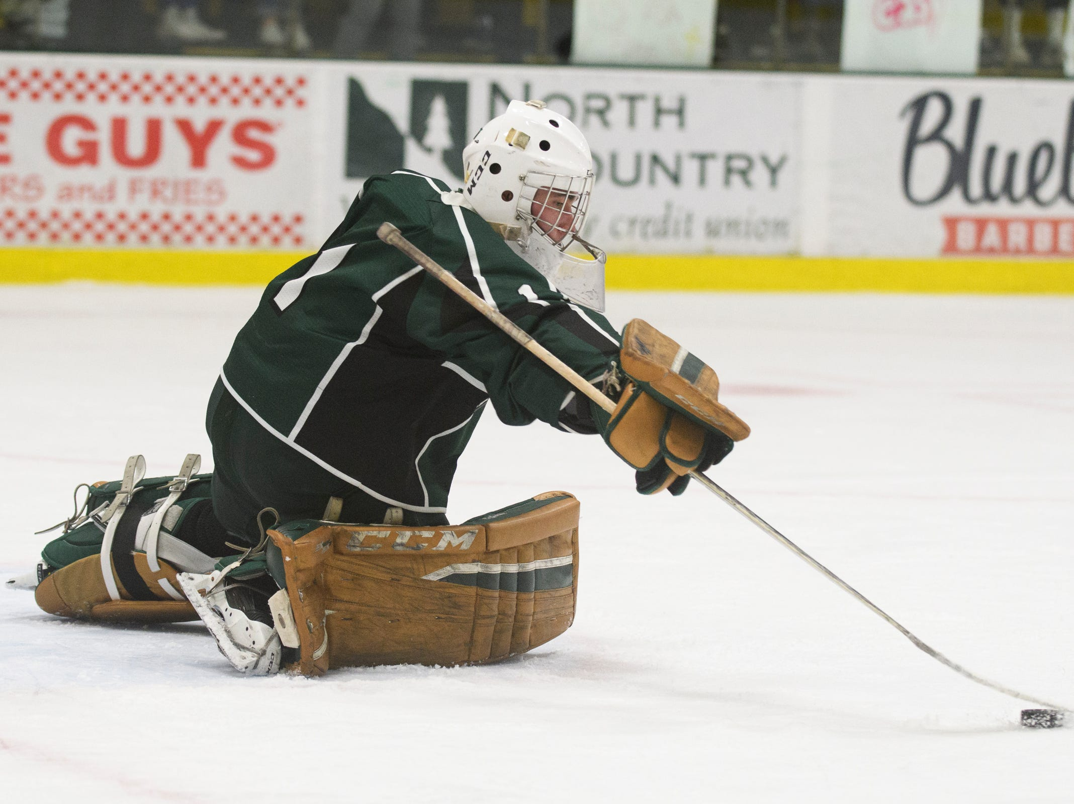 Rice goalie Cale Lyman (1) makes a stick save during the DI boys hockey championship game between the Rice Green Knights and the Essex Hornets at Gutterson Field House on Wednesday night March 13, 2019 in Burlington, Vermont.