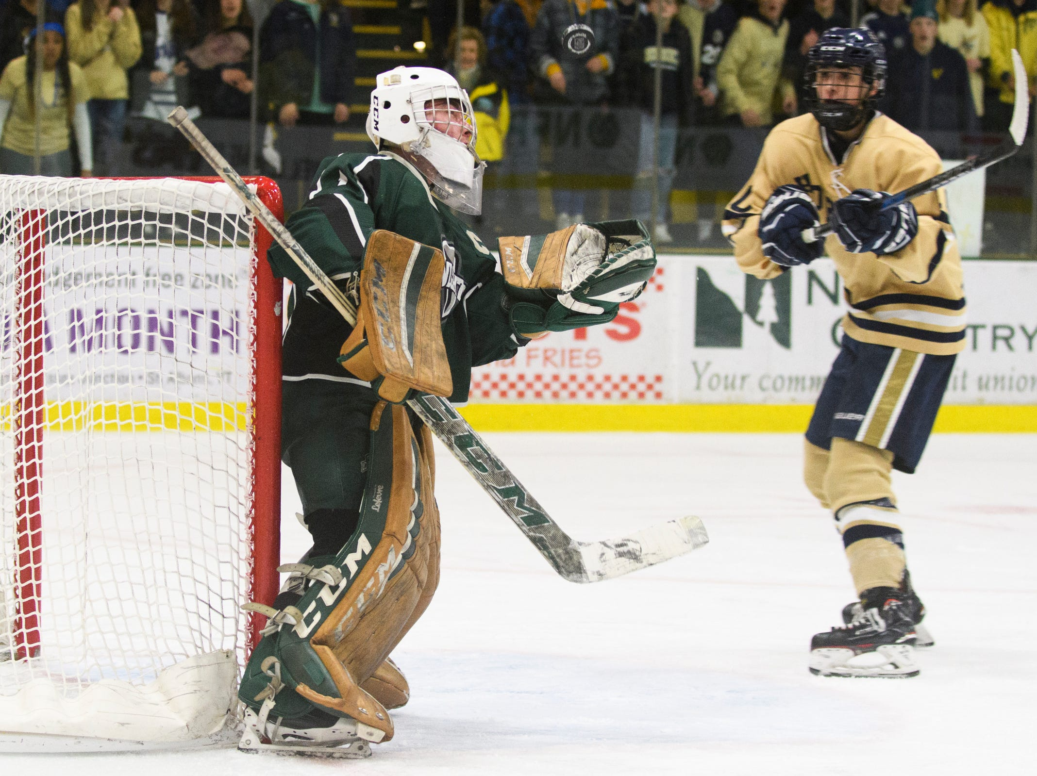 Rice goalie Cale Lyman (1) catches the puck in his glove during the DI boys hockey championship game between the Rice Green Knights and the Essex Hornets at Gutterson Field House on Wednesday night March 13, 2019 in Burlington, Vermont.
