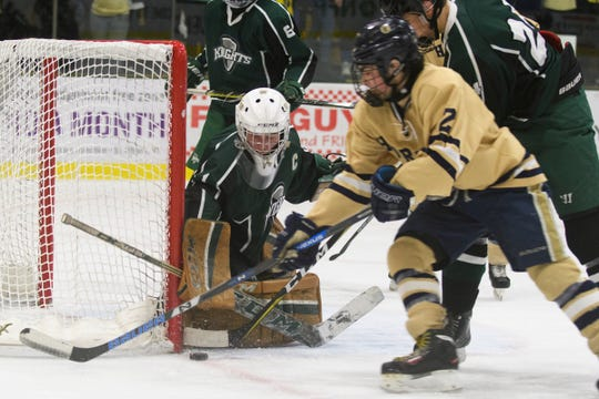 Rice goalie Cale Lyman (1) keeps an eye on the puck during the DI boys hockey championship game between the Rice Green Knights and the Essex Hornets at Gutterson Field House on Wednesday night March 13, 2019 in Burlington, Vermont.