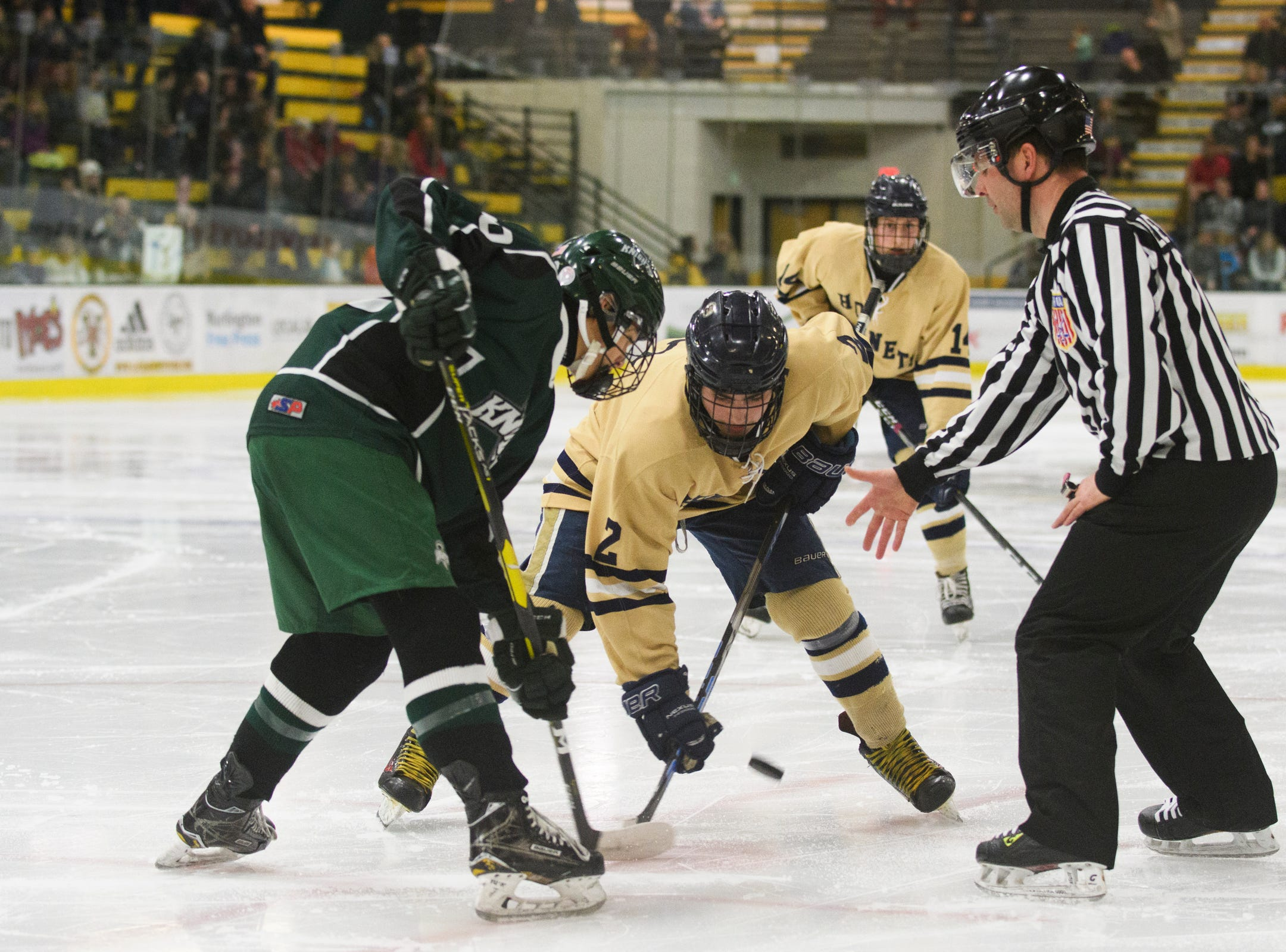 Essex and Rice face off during the DI boys hockey championship game between the Rice Green Knights and the Essex Hornets at Gutterson Field House on Wednesday night March 13, 2019 in Burlington, Vermont.
