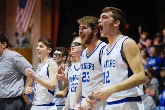 Drew Drageset (23) reacts with his teammates during No. 3 Lake Region's  37-23 win over No. 7 Milton in a Division II semifinal at Barre  Auditorium on Wednesday, March 13, 2019. The Rangers advance to their  first state final since 2010 and face No. 1 Mt. St. Joseph on Saturday.