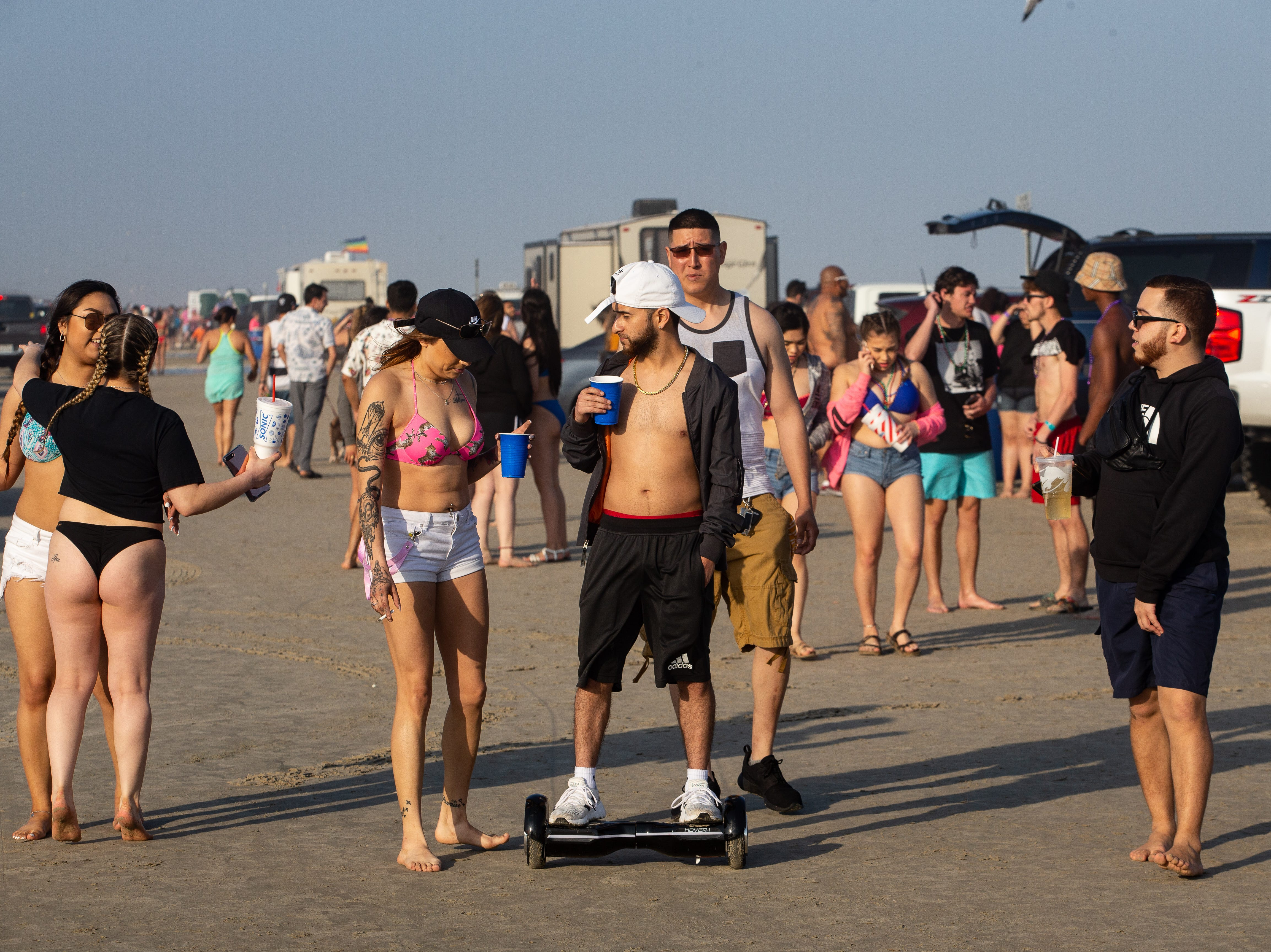 People celebrate spring break 2019 on the beach in Port  Aransas on Wednesday, March, 13, 2019.