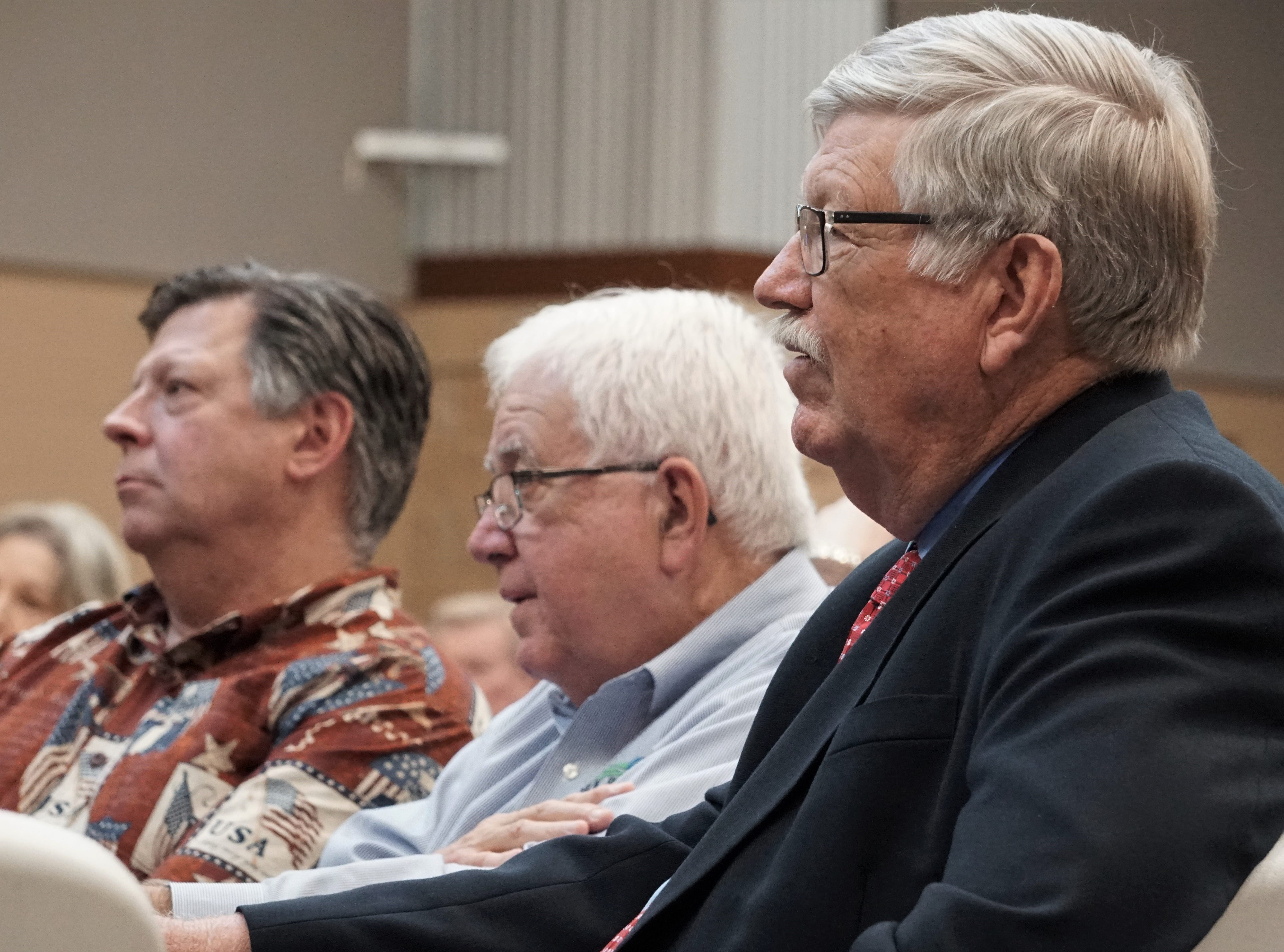 San Patricio County Judge David Krebs, right, listens to representatives with Steel Dynamics address the audience during a meet and greet at the San Patricio County Civic Center in Sinton on March 13, 2019.