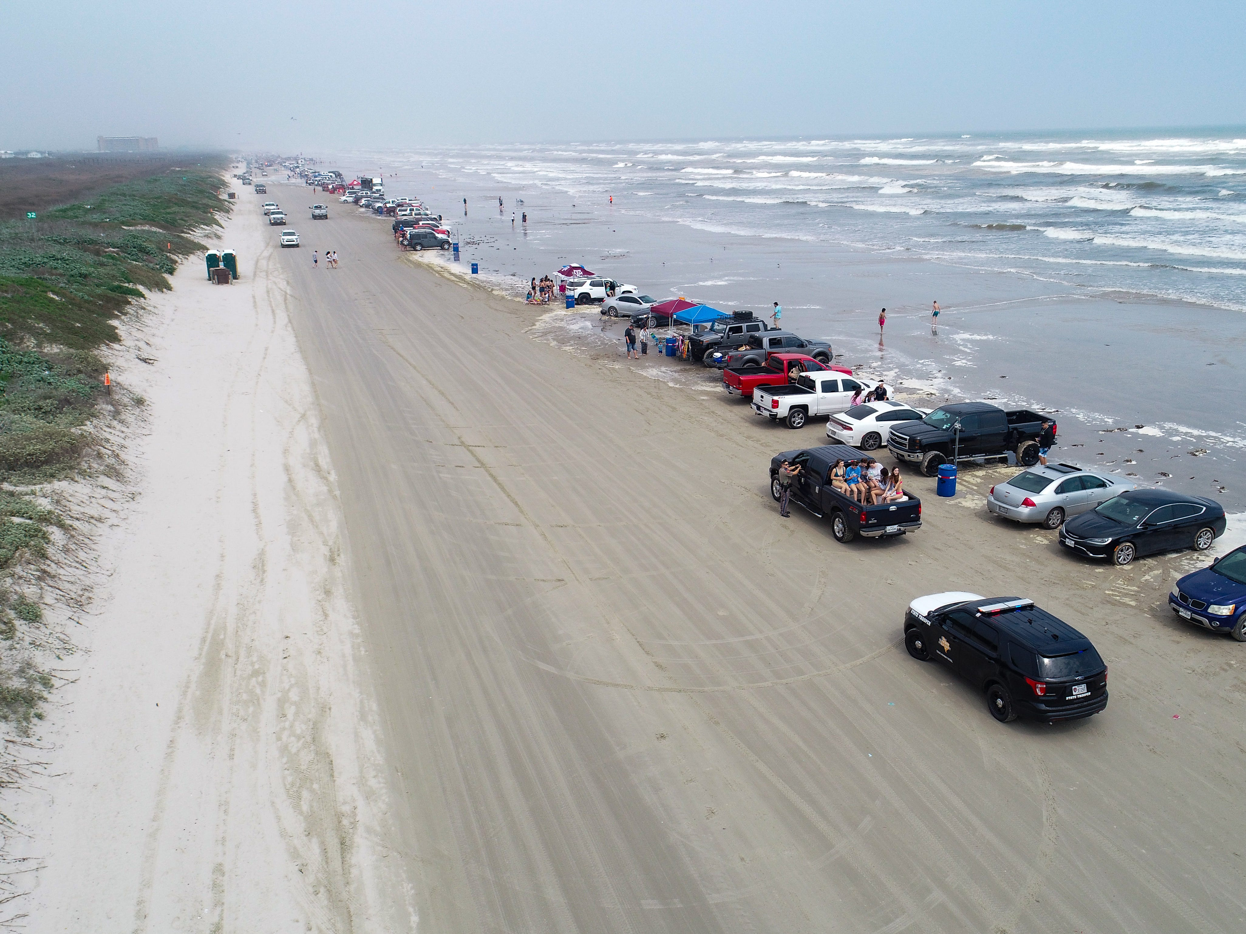Cars line the beach in Port Aransas during Spring Break 2019 on Wednesday, March, 13, 2019.