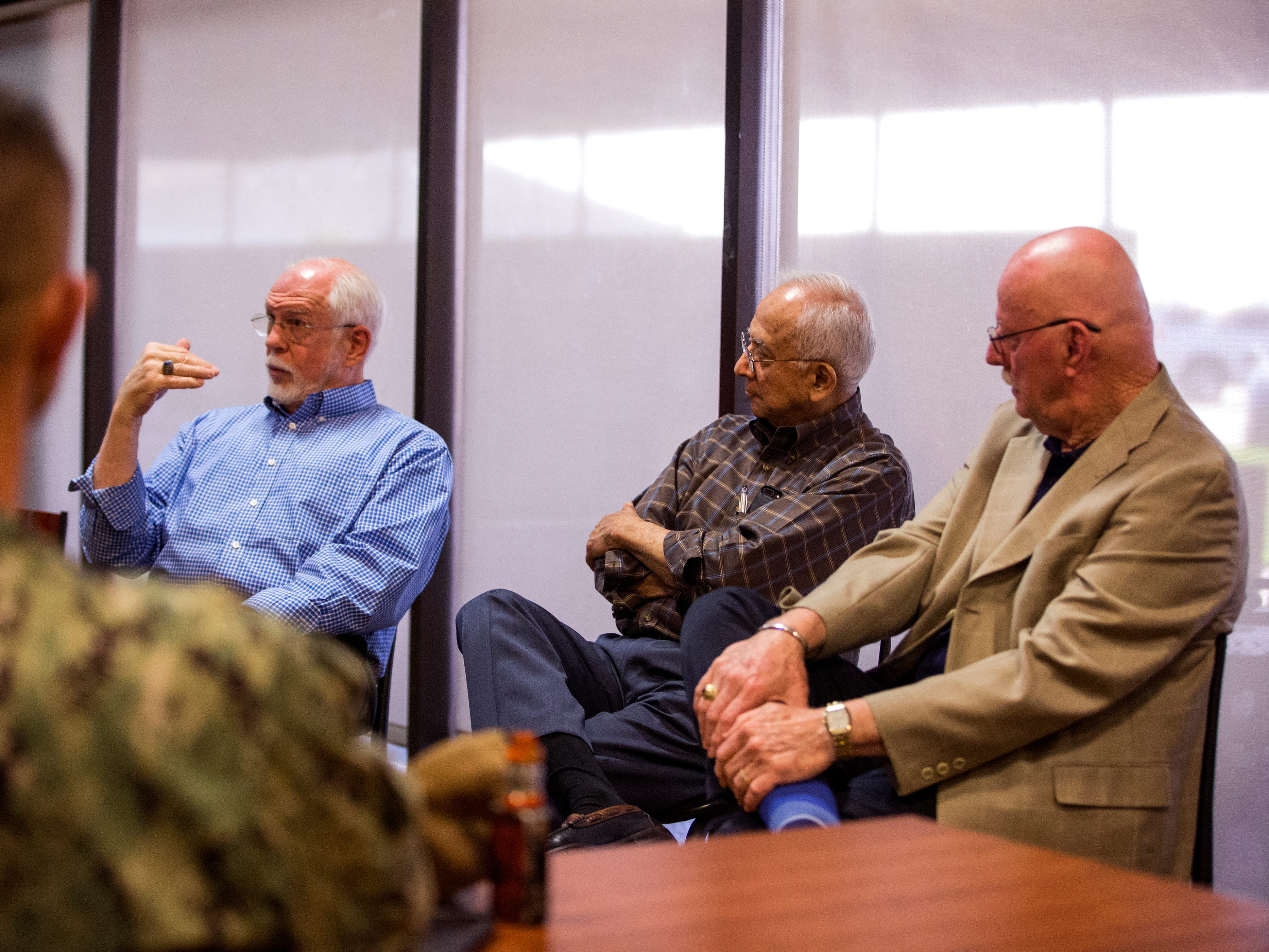 Former POWs retired Col. Dr. Thomas McNish (from left), retired Lt. Cmdr. Everett Alvarez Jr. and Capt. David Carey speak to pilots at Naval Air Station Kingsville on Wednesday, March 14, 2019 about their experiences. Alvarez said one of the things that helped them survive captivity was sticking together with a common goal of getting home.