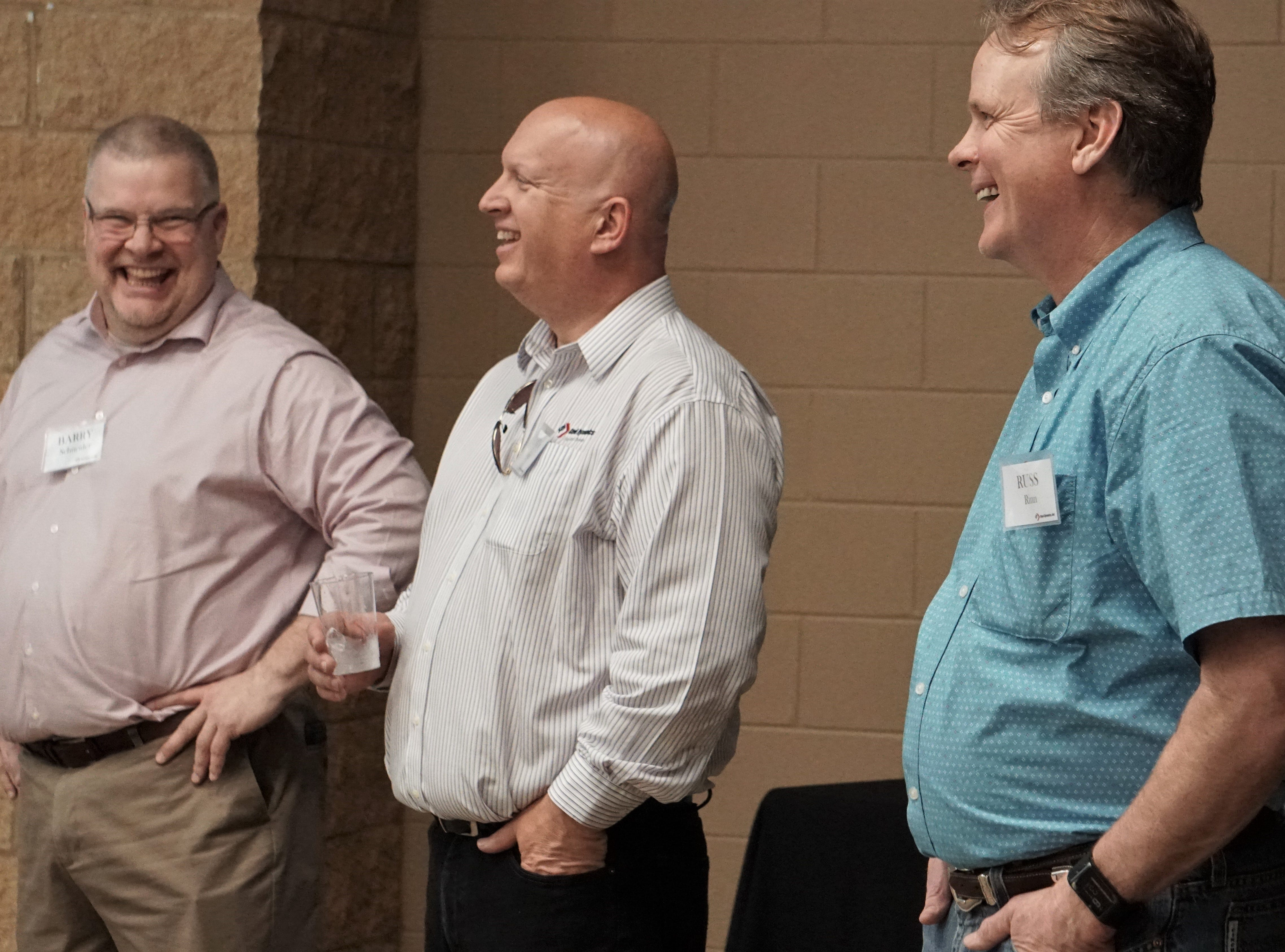 From left are Steel Dynamics executives Barry Schneider, Glenn Pushis and Russ Rinn as they listen to the company's CEO Mark Millett speak during a meet and greet in Sinton on March 14, 2019.