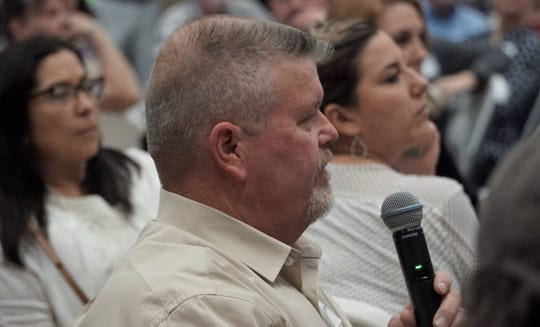 Taft resident Larry Thormaehlen poses a question to Steel Dynamics CEO Mark Millett during a meet and greet at the San Patricio County Civic Center in Sinton on March 13, 2019.