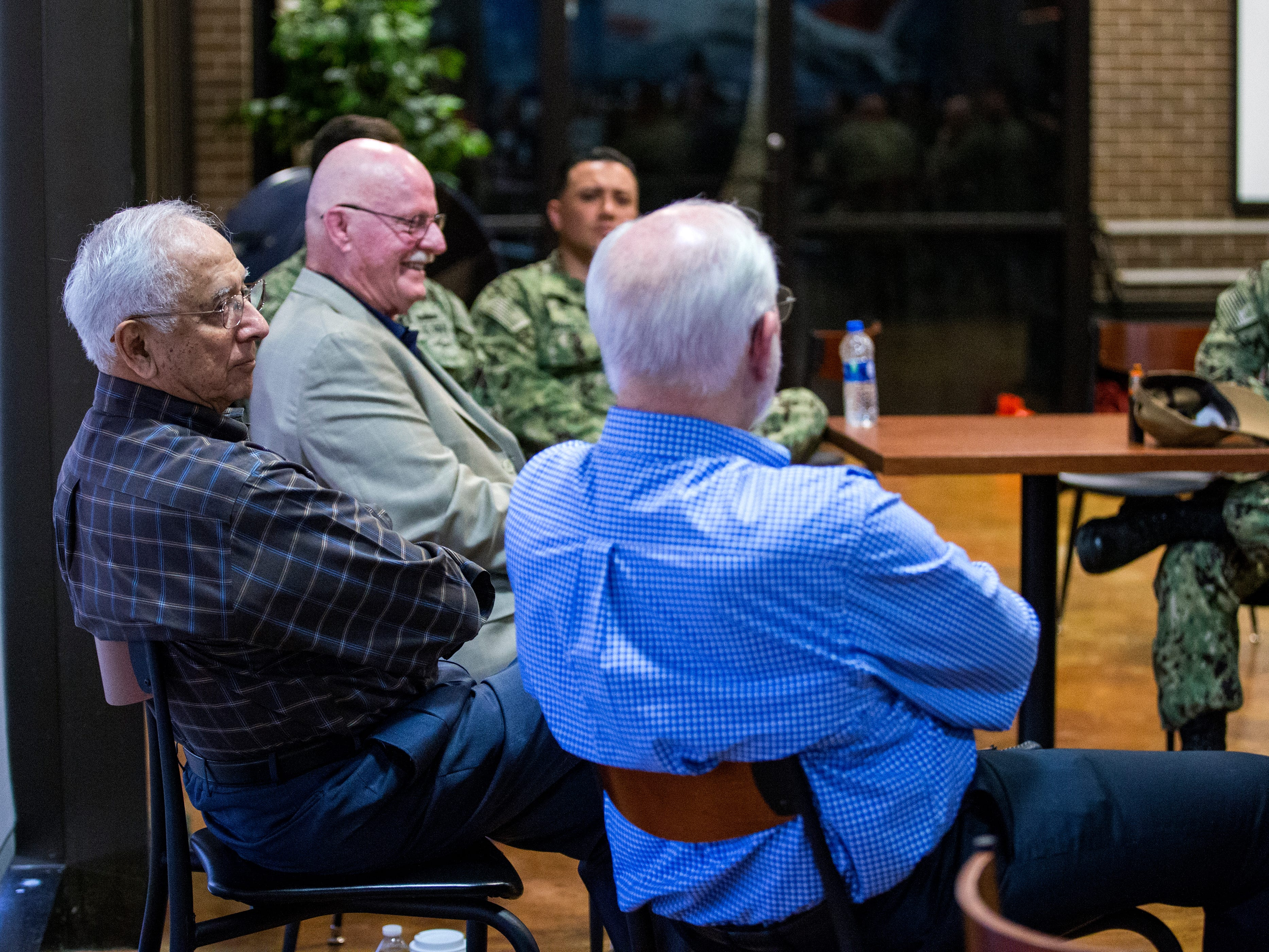 Former POWs retired Col. Dr. Thomas McNish (from front), retired Cmdr. Everett Alvarez Jr. and Capt. David Carey speak to pilots at Naval Air Station Kingsville on Wednesday, March 14, 2019 about their experiences. Alvarez said one of the things that helped them survive captivity was sticking together with a common goal of getting home.