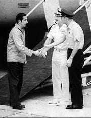 Former POW Lt. Cmdr. Everett Alvarez Jr. is greeted by Adm. Noel Gayler, commander-in-chief, Pacific, and Lt. Gen. William G. Moore, 13th Air Force commander, at Clark Air Base, Philippines, in February 1973.
