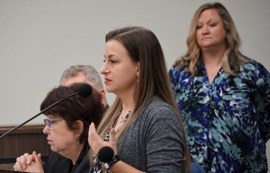 Sharra Rodriguez, the new victim assistance coordinator for the Nueces County District Attorney's Office, addresses county commissioners on March 13, 2019.