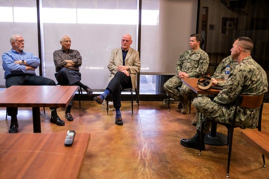 Former POWs retired Col. Dr. Thomas McNish (from left), retired Cmdr. Everett Alvarez Jr. and Capt. David Carey speak to pilots at Naval Air Station Kingsville on Wednesday about their experiences. Alvarez said one of the things that helped them survive captivity was sticking together with a common goal of getting home.