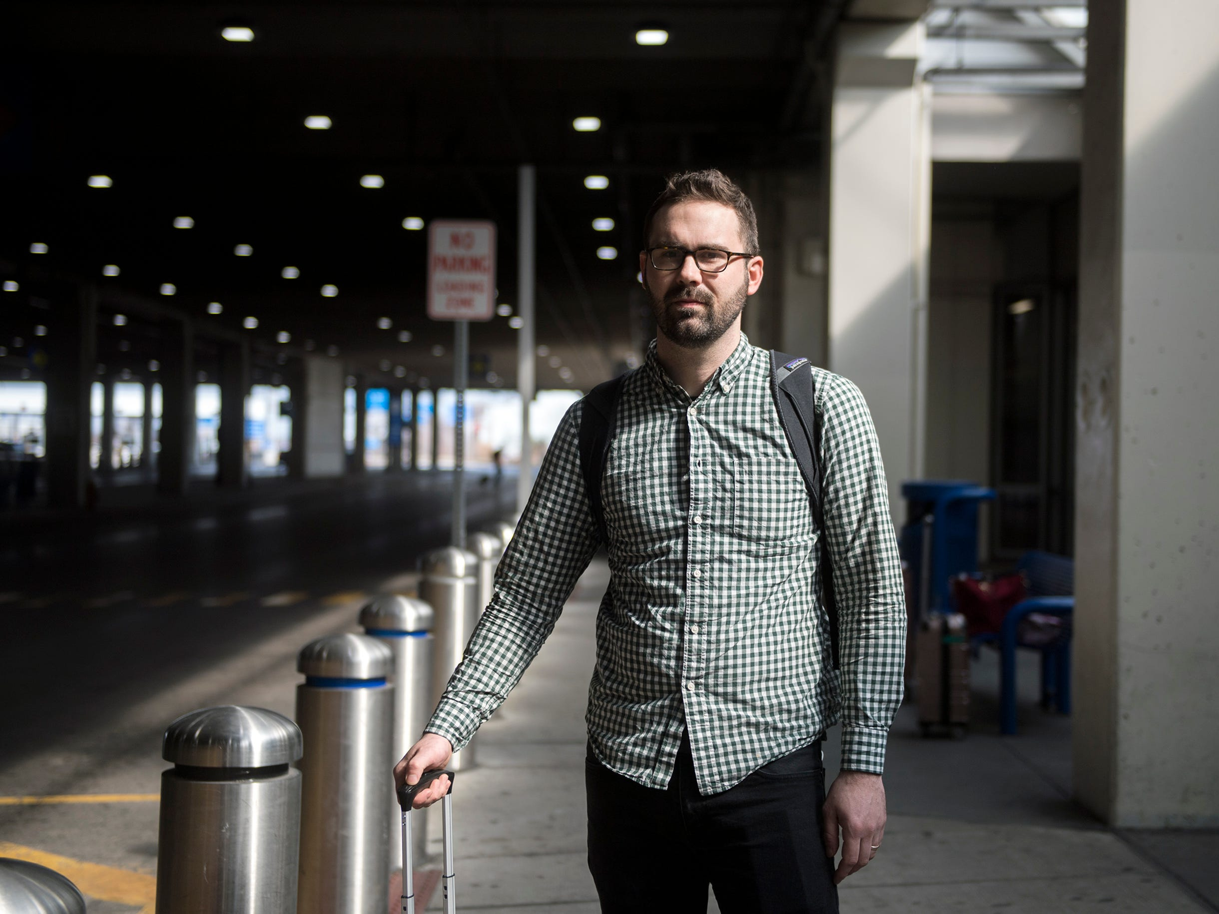 John Transue, 34, of Mount Laurel poses outside baggage claim Thursday, March 14, 2019 at Philadelphia International Airport in Philadelphia, Pa. Transue was traveling from Atlanta and supports the decision to ground the Boeing 737 Max planes.