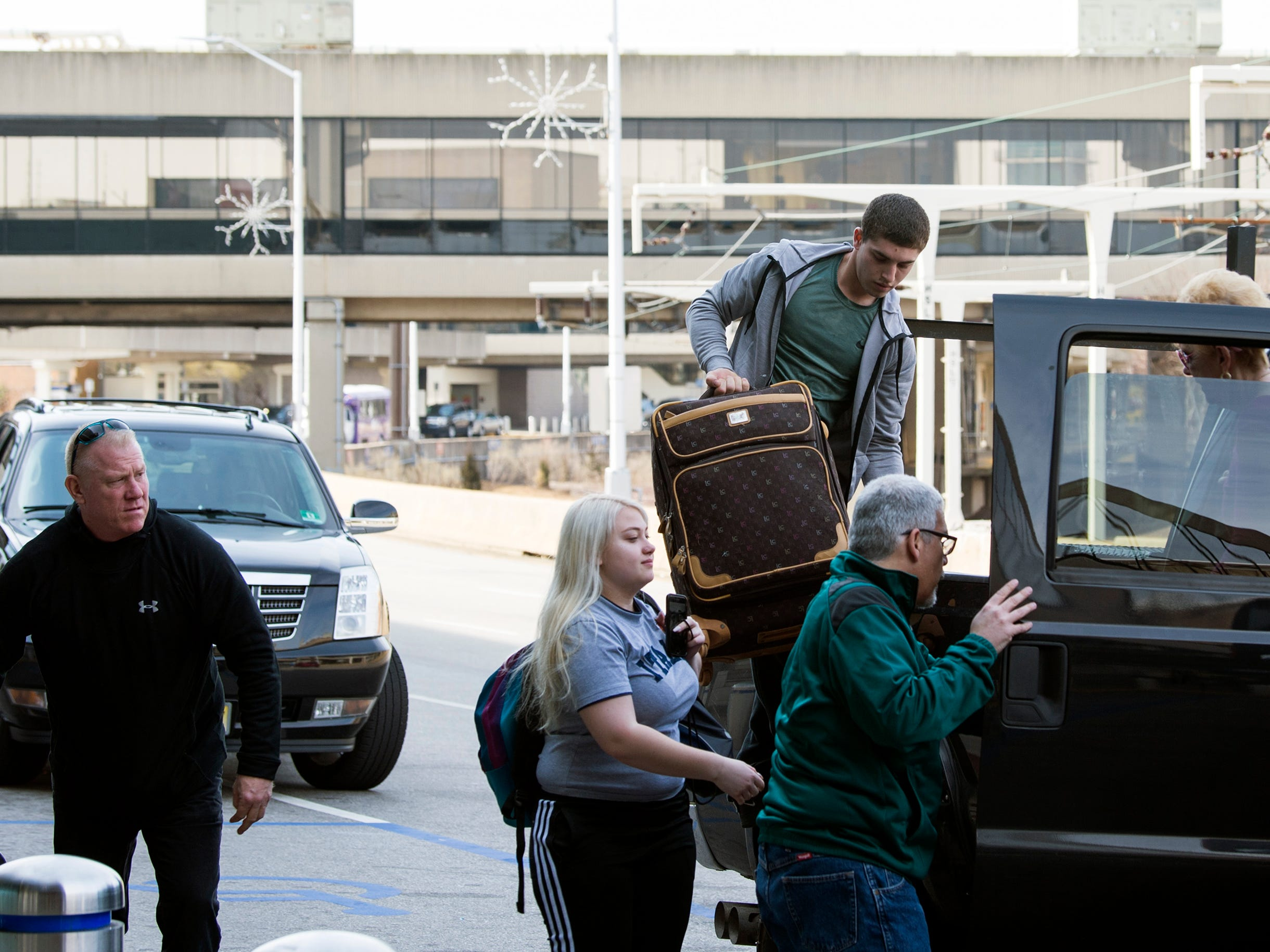 Travelers gather their luggage Thursday, March 14, 2019 at Philadelphia International Airport in Philadelphia, Pa.