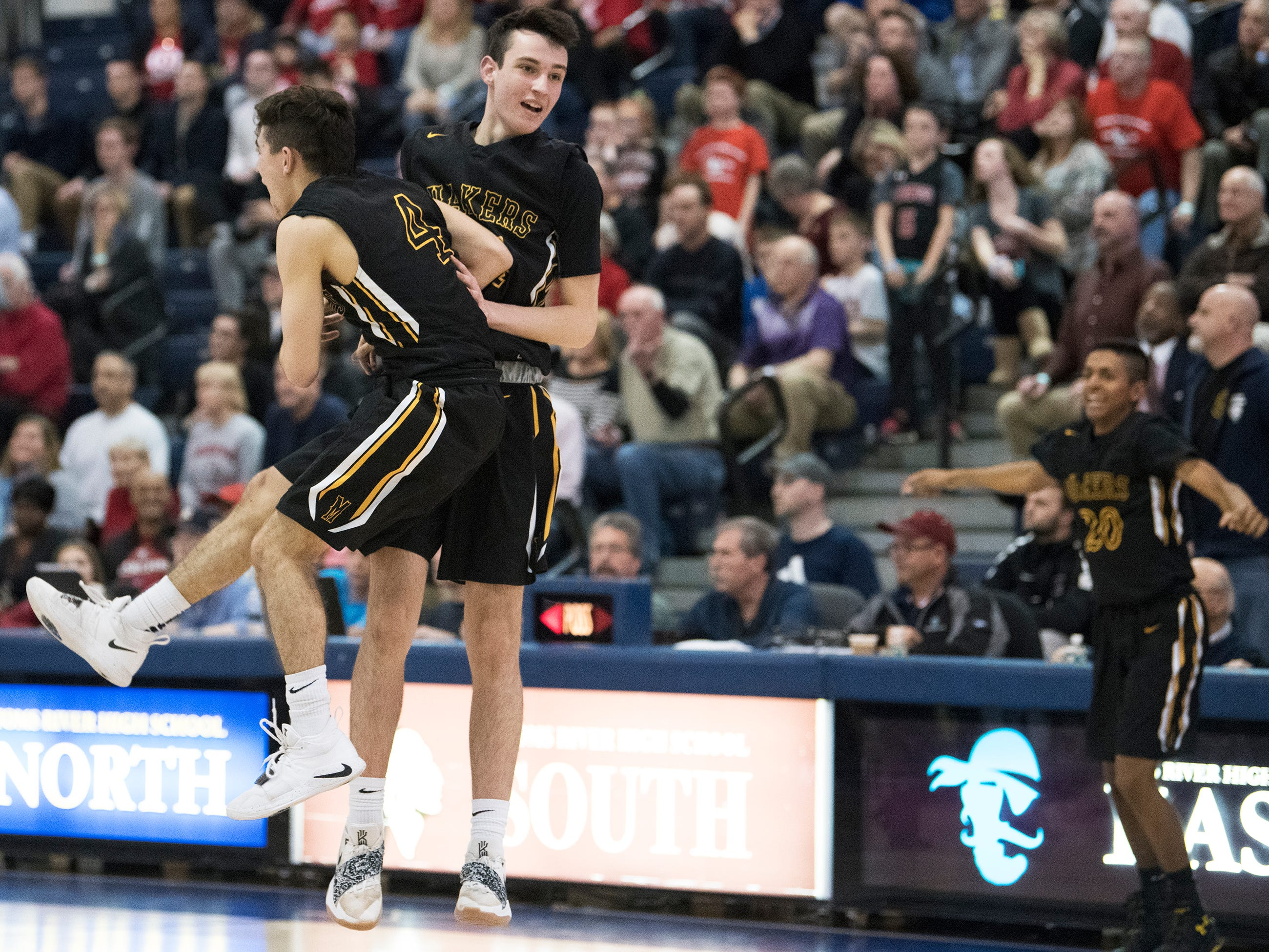 Moorestown's Jagger Zrada, left, celebrates with teammate Evan Francisco after Moorestown defeated Haddonfield, 60-59, during the boys basketball Tournament of Champions quarterfinal game played at Toms River North High School on Wednesday, March 13, 2019.