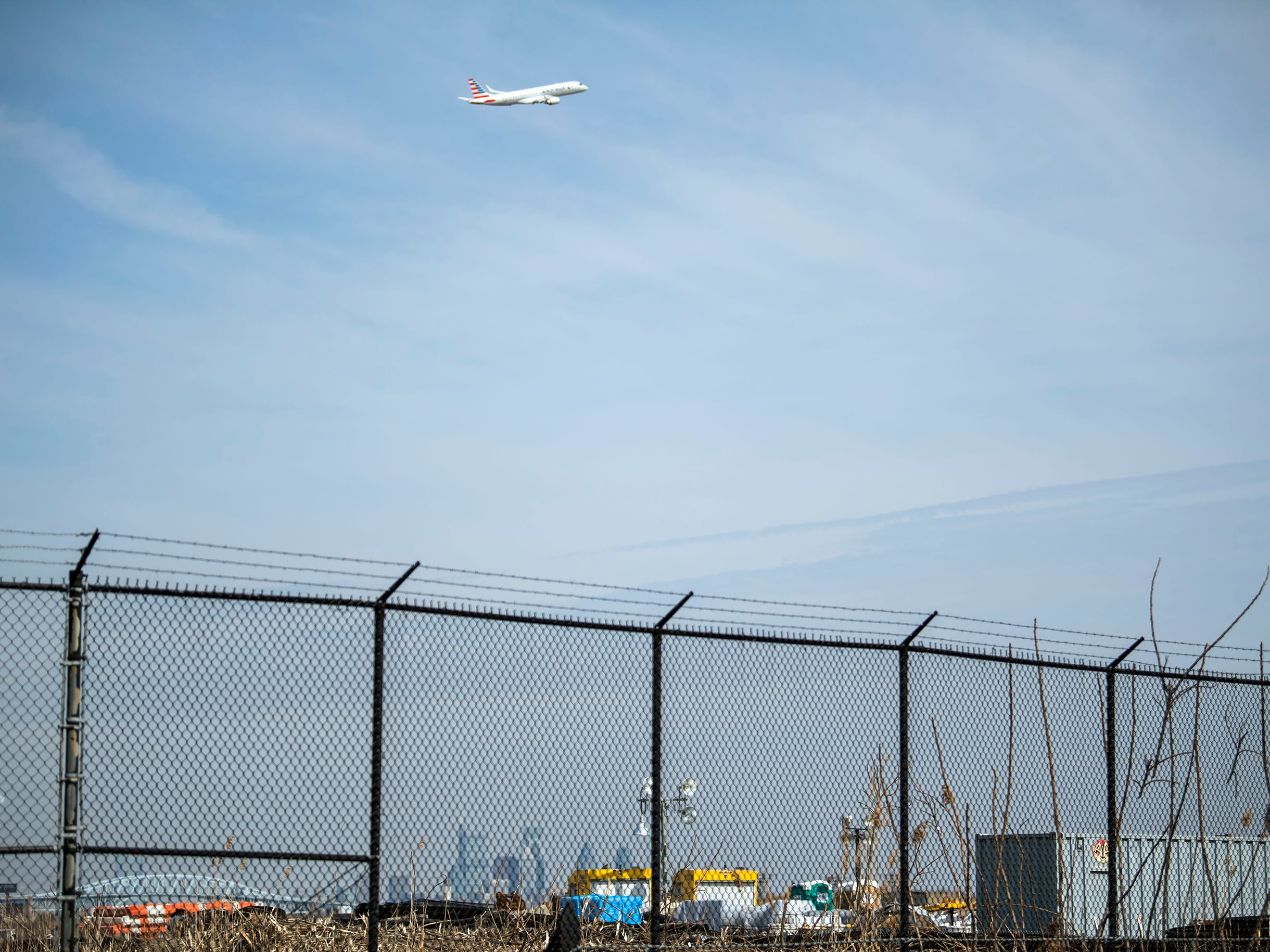 The skyline is seen as a plane takes off Thursday, March 14, 2019 at Philadelphia International Airport in Philadelphia, Pa.