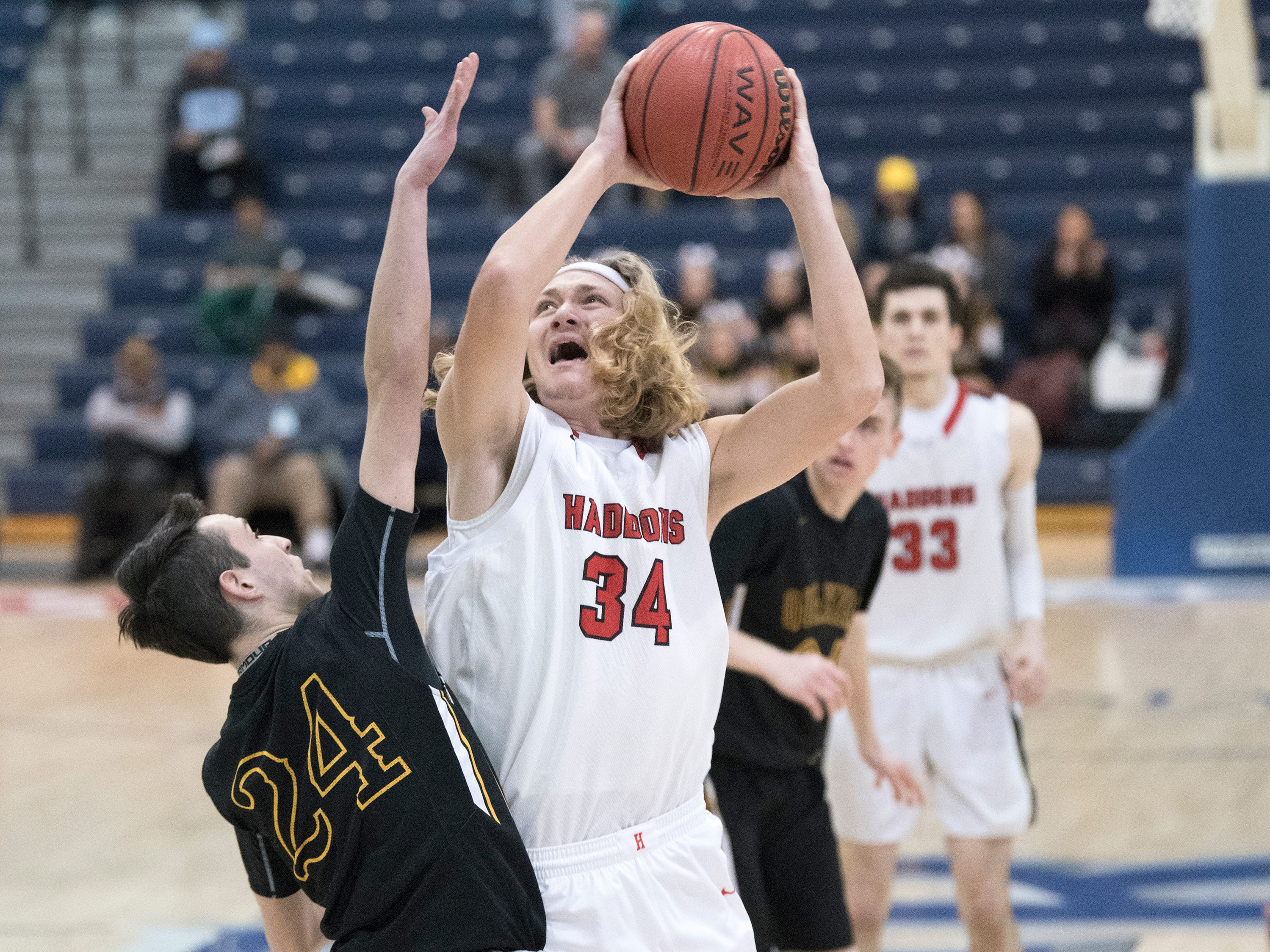 Haddonfield's Dylan Heine puts up a shot as Moorestown's Evan Francisco defends during the boys basketball Tournament of Champions quarterfinal game played at Toms River North High School on Wednesday, March 13, 2019.    Moorestown defeated Haddonfield, 60-59.