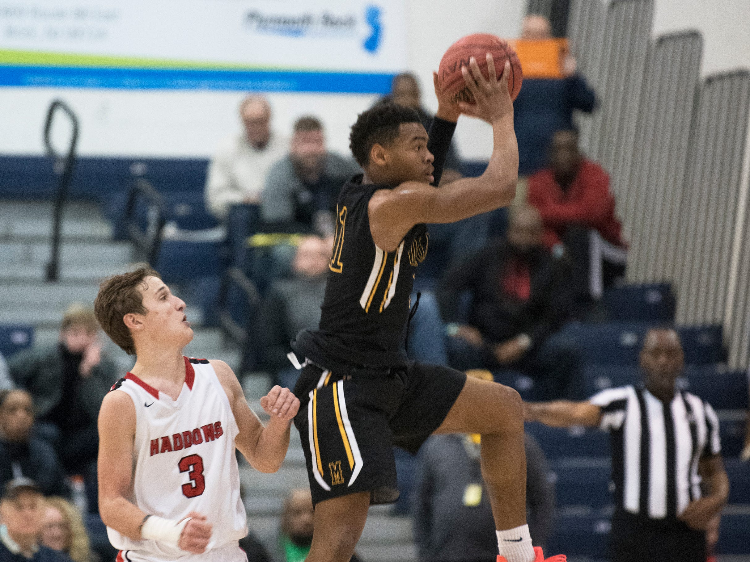 Moorestown's Nick Cartwright-Atkins grabs a loose ball next to Haddonfield's Mike DePersia during the 3rd quarter of the boys basketball Tournament of Champions quarterfinal game played at Toms River North High School on Wednesday, March 13, 2019.    Moorestown defeated Haddonfield, 60-59.