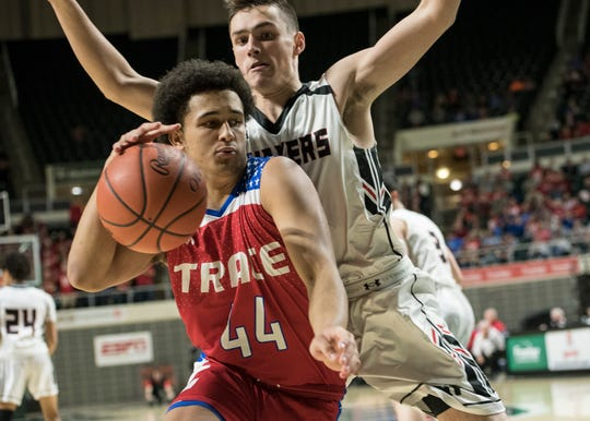 Junior Triton Davidson posts up a New Philadelphia defender during the first half of Zane Trace's Division II regional semifinal game at Ohio University's Convocation Center on March 13, 2019.  New Philadelphia defeated Zane Trace 50-43.