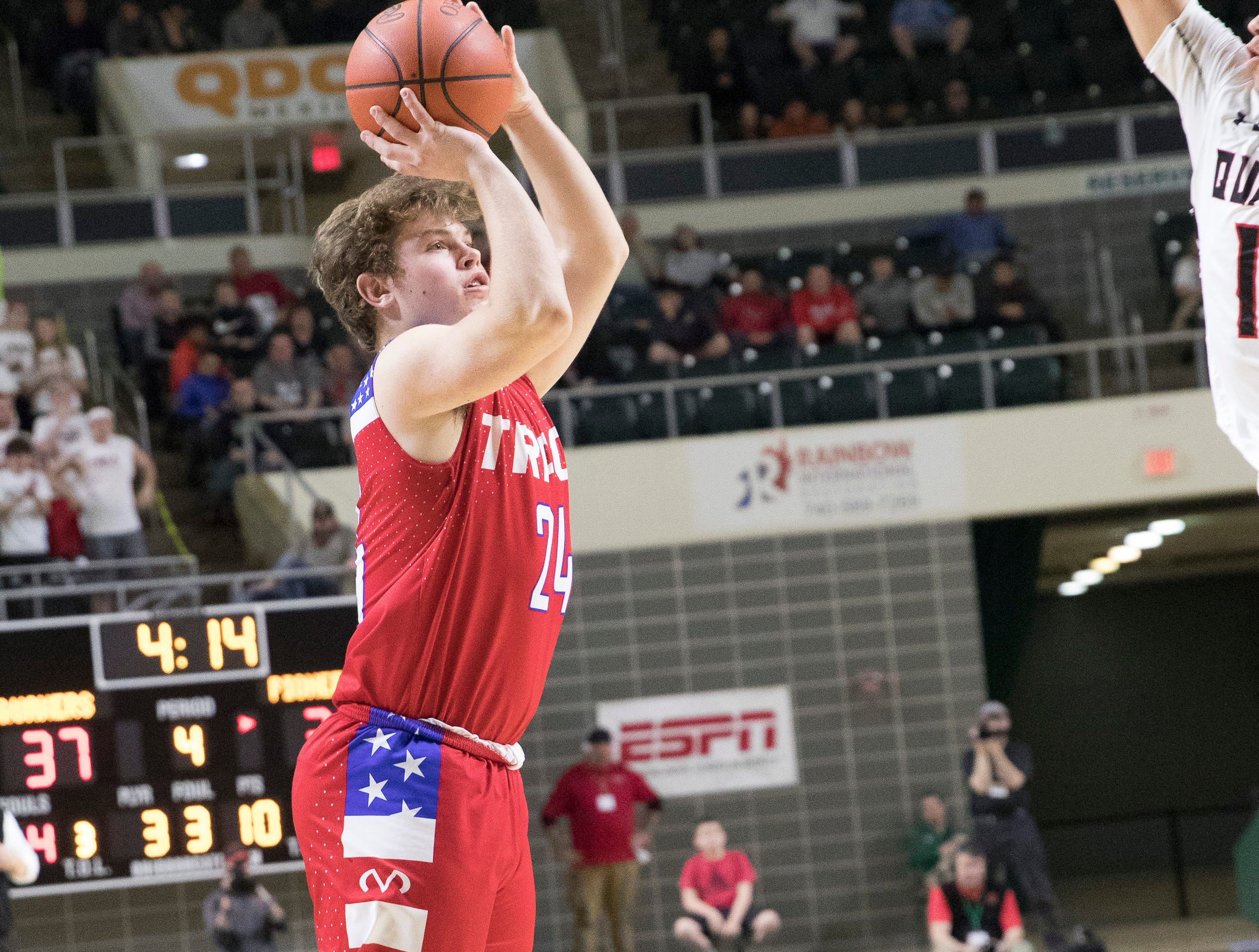 Senior Chad Ison attempts a jump shot during the second half of Zane Trace's Division II regional semifinal game against New Philadelphia at Ohio University's Convocation Center on March 13, 2019.