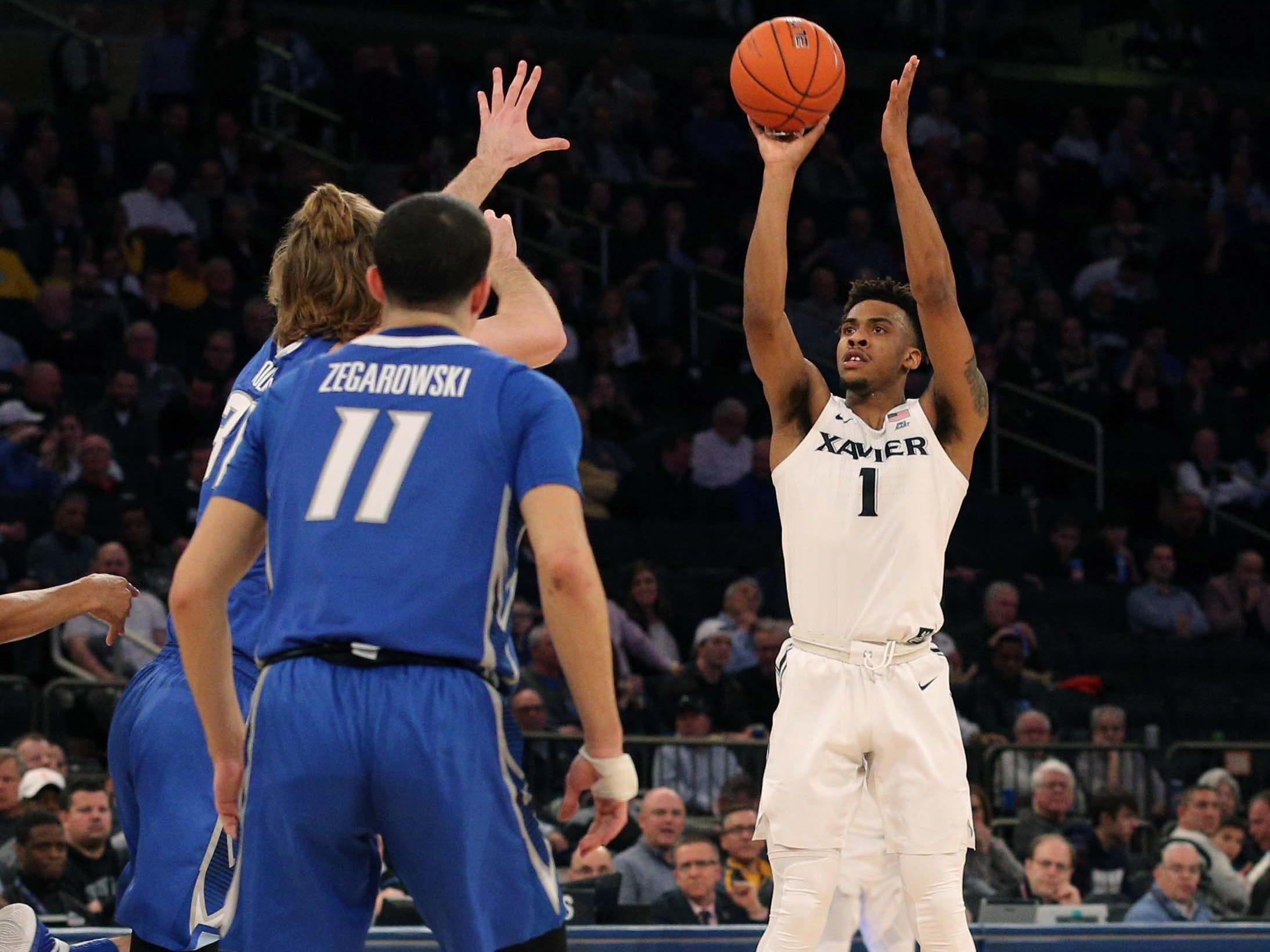 Xavier Musketeers guard Paul Scruggs (1) shoots a three point shot against the Creighton Bluejays during the first half of a quarterfinal game of the Big East conference tournament at Madison Square Garden.