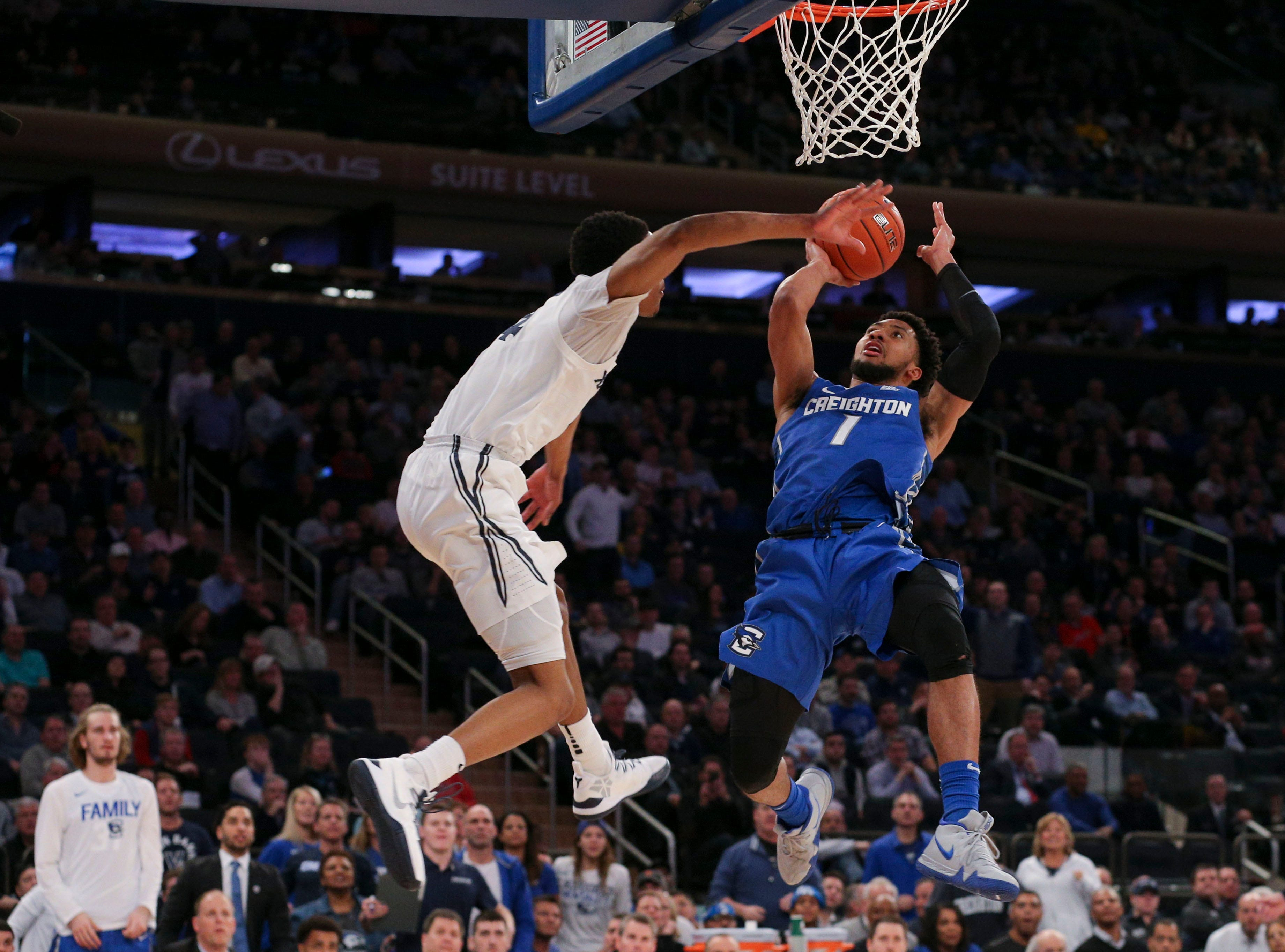 Creighton Bluejays guard Davion Mintz (1) is fouled as he drives to the basket by Xavier Musketeers guard Elias Harden (4) during the second half of a quarterfinal game of the Big East conference tournament at Madison Square Garden.