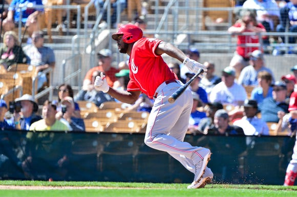 Cincinnati Reds right fielder Yasiel Puig (66) singles in the first inning against the Los Angeles Dodgers at Camelback Ranch.