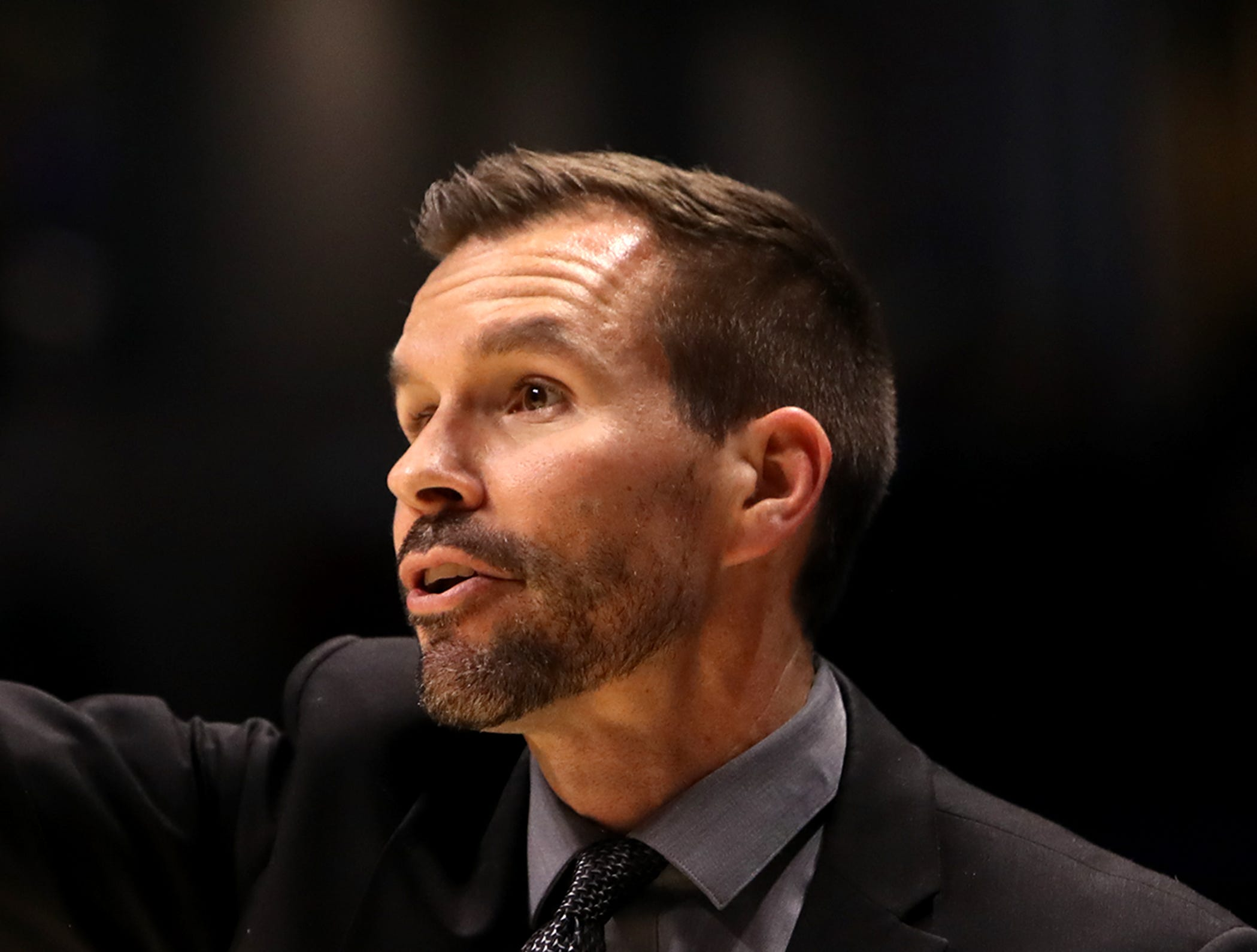 Lakota East head coach Clint Adkins gives instructions to his team in the boys regional semifinal March 13, 2019, at Xavier University's Cintas Center. Moeller defeated Lakota East 47-33.