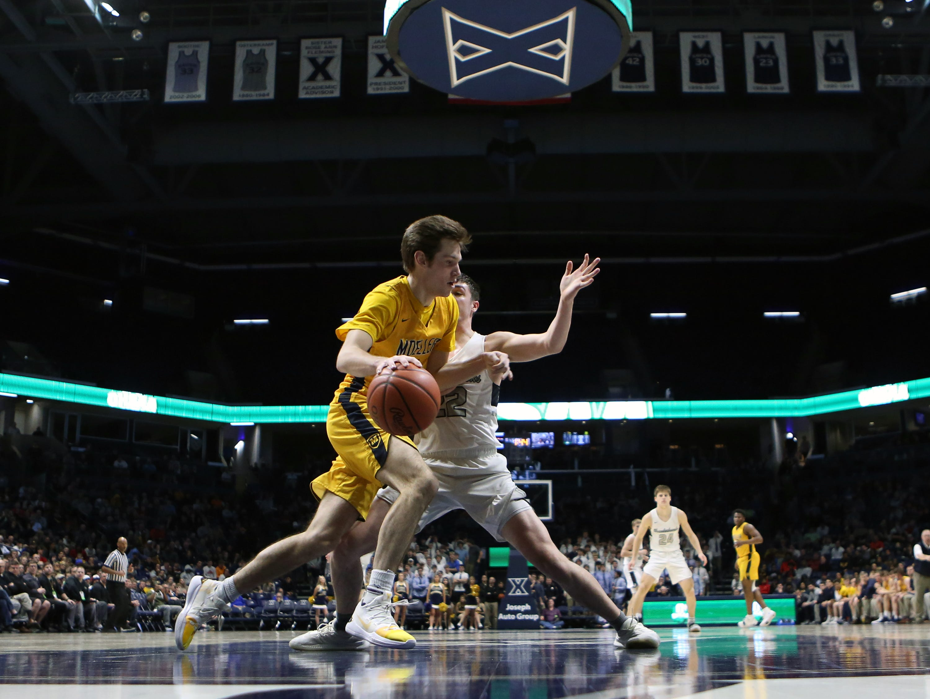 Moeller guard Michael Shipp looks to get past the Thunderhawk defense in the second half of the boys regional semifinal March 13, 2019, at Xavier University's Cintas Center. Moeller defeated Lakota East 47-33.