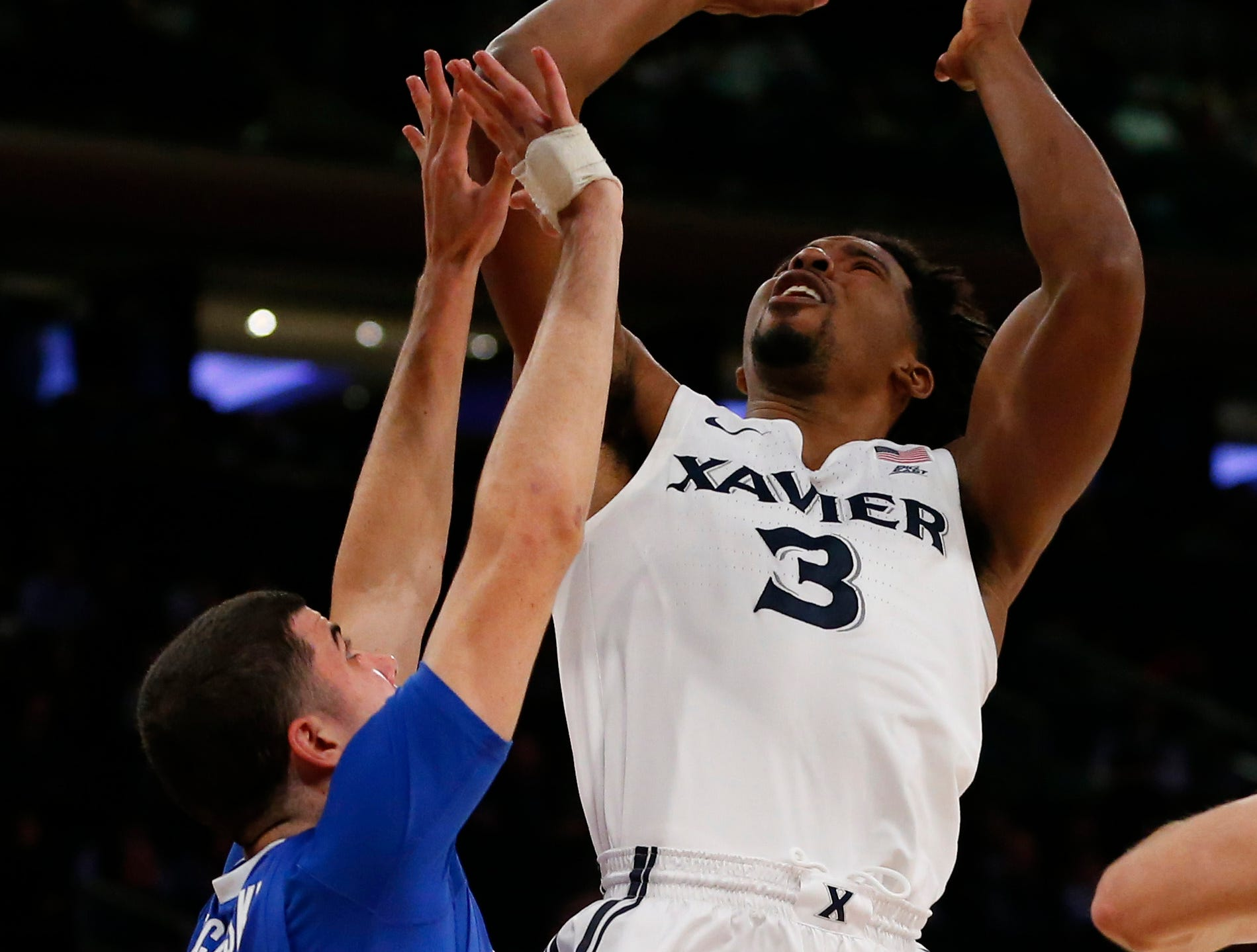Xavier Musketeers guard Quentin Goodin (3) shoots over Creighton Bluejays guard Marcus Zegarowski (11) during the second half of a quarterfinal game of the Big East conference tournament at Madison Square Garden. Mandatory Credit: Noah K. Murray-USA TODAY Sports