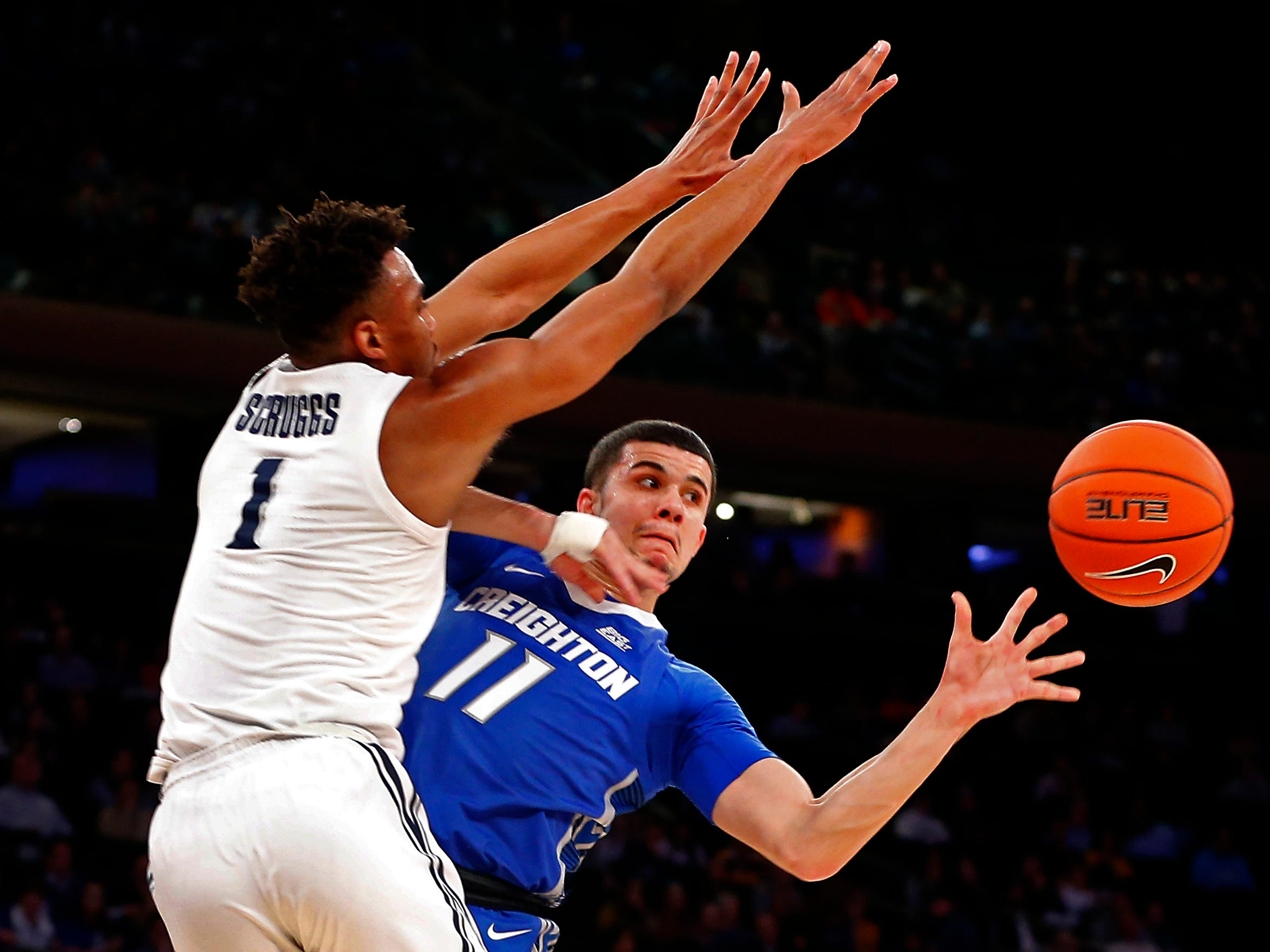 Xavier Musketeers guard Paul Scruggs (1) defends against Creighton Bluejays guard Marcus Zegarowski (11) during the first half of a quarterfinal game of the Big East conference tournament at Madison Square Garden. Mandatory