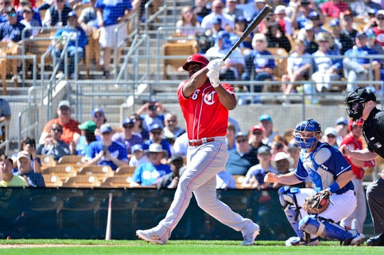 Cincinnati Reds right fielder Yasiel Puig (66) at bat in the first inning against the Los Angeles Dodgers at Camelback Ranch.