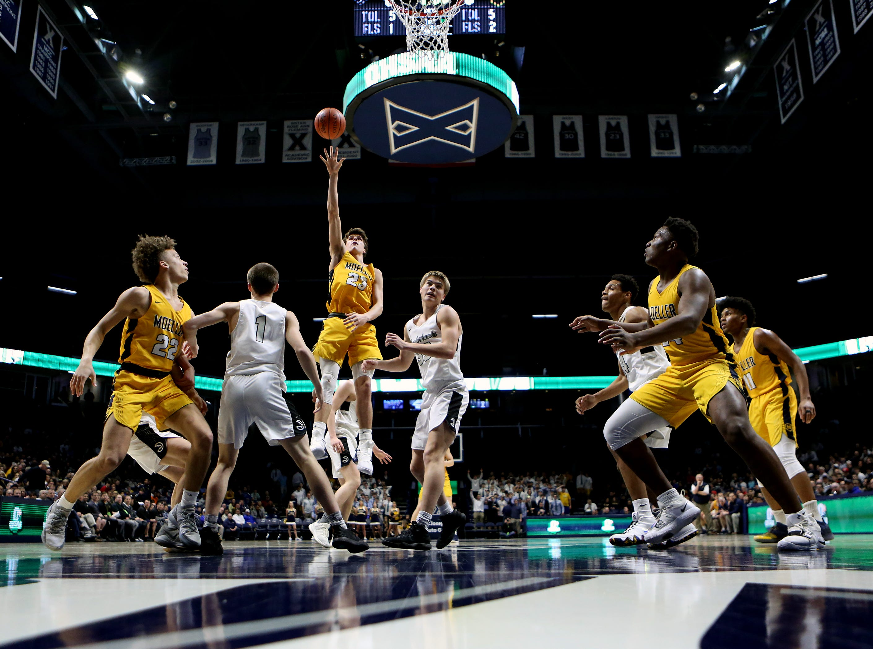 Moeller forward Will McCracken shoots and scores in the second half of the boys regional semifinal March 13, 2019, at Xavier University's Cintas Center. Moeller defeated Lakota East 47-33.
