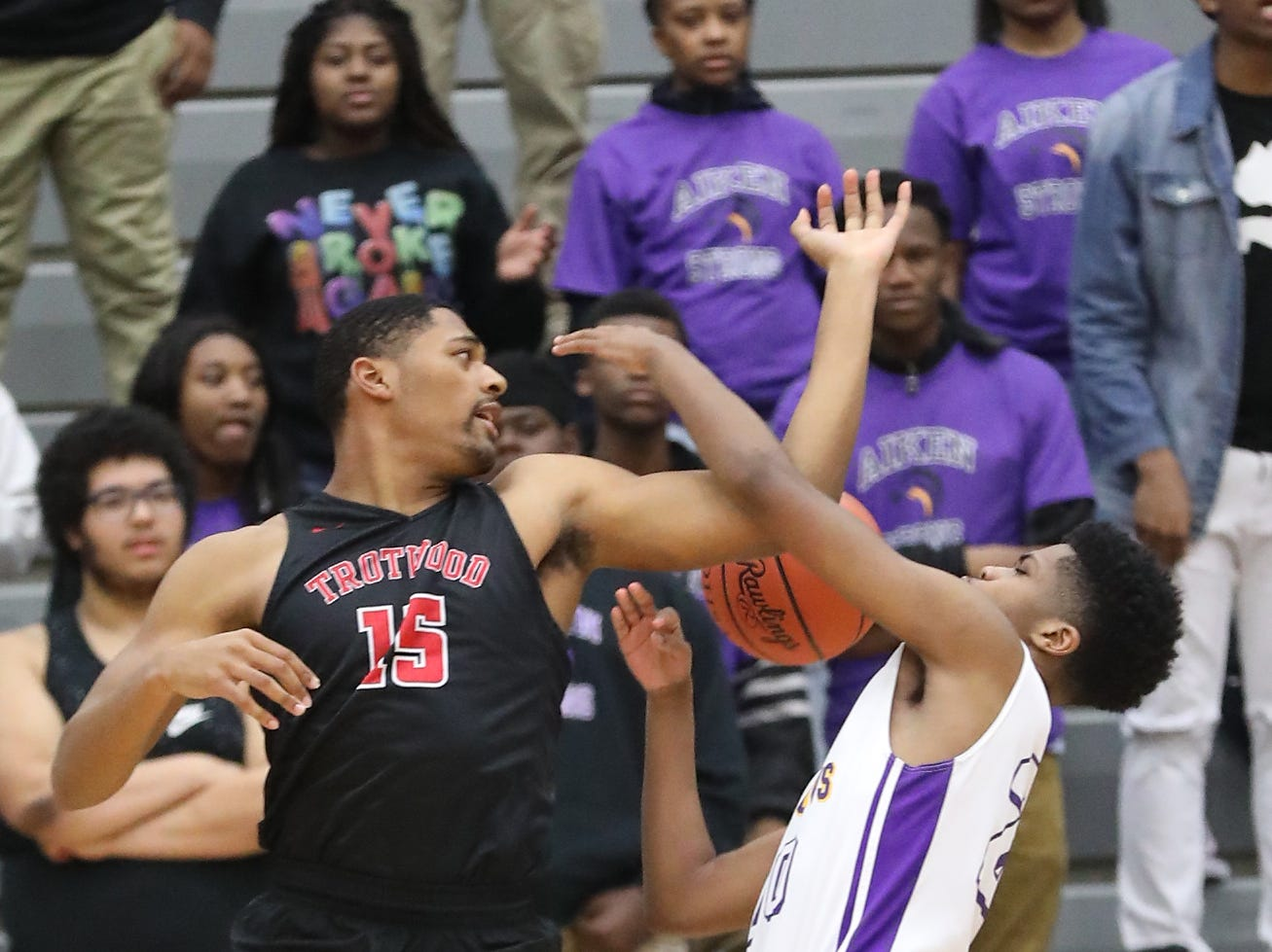 Aiken forward LeBraun Berry (20) battles Trotwood Madison forward  Justin Stephens during the Falcons regional semifinal game , Thursday, March 14, 2019.