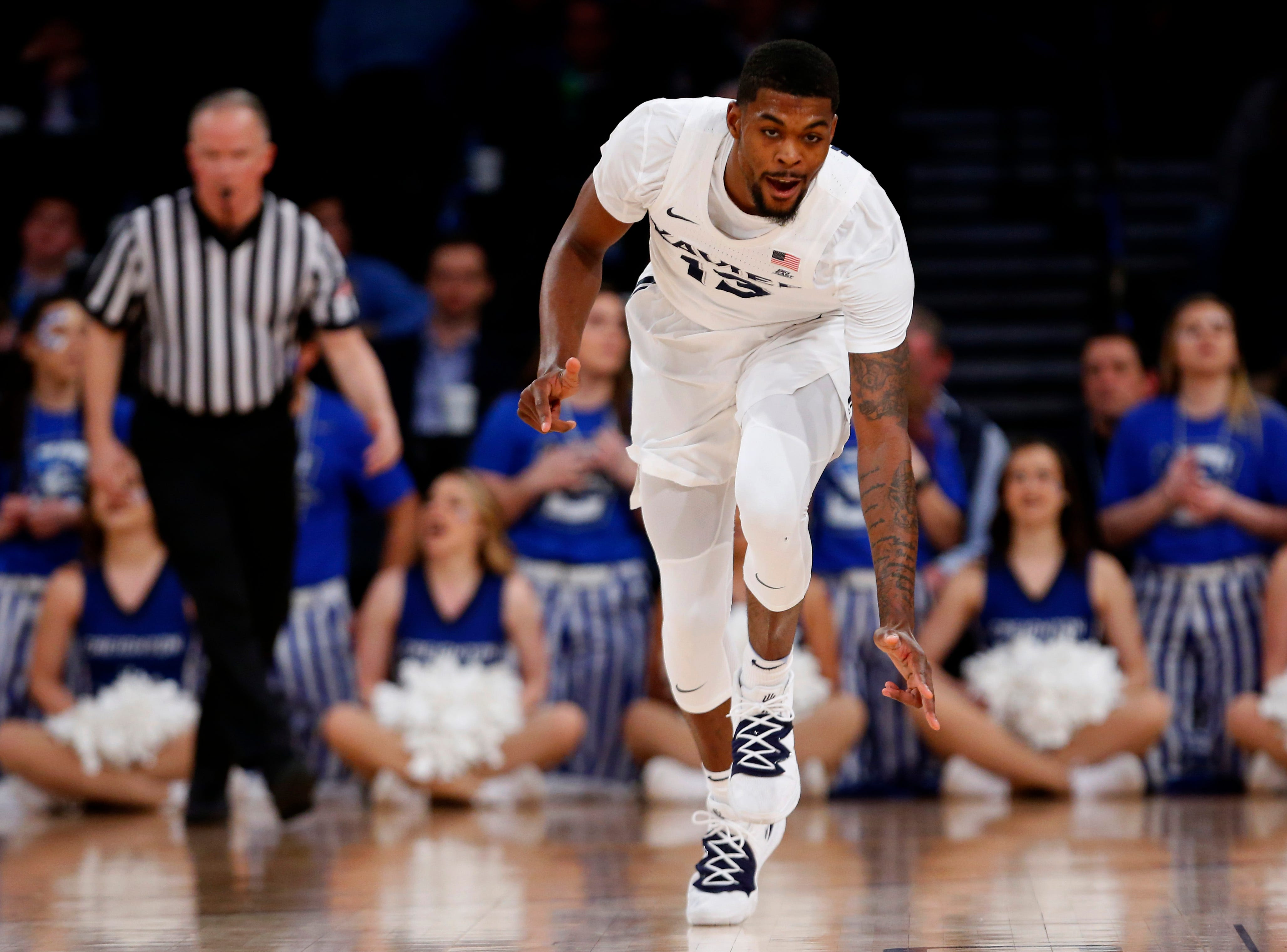 Xavier Musketeers forward Naji Marshall (13) reacts after making a three-point shot against the Creighton Bluejays during the first half of a quarterfinal game of the Big East conference tournament at Madison Square Garden.