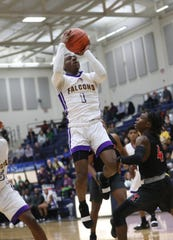 Aiken guard D'Arris Dean drives to the basket during the Falcons regional semifinal game against Trotwood Madison, Thursday, March 14, 2019. Dean scored 23 points to lead the Falcons.