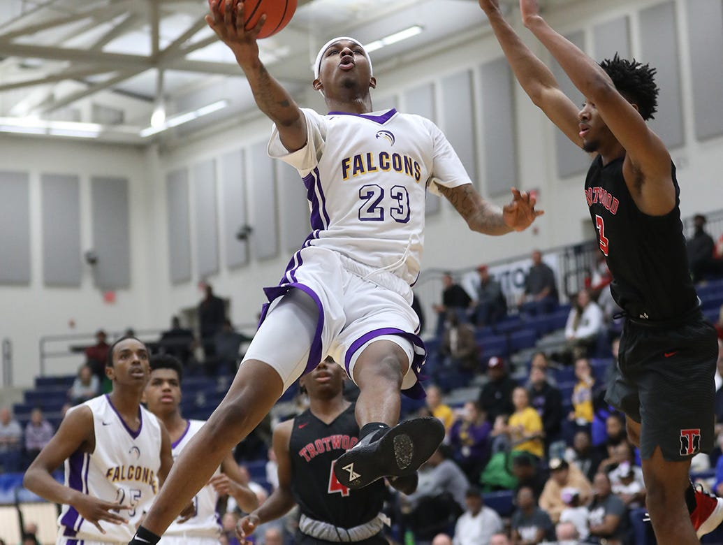 Aiken forward Jermaine Smith drives to the basket during the Falcons regional semifinal game against Trotwood Madison, Thursday, March 14, 2019.
