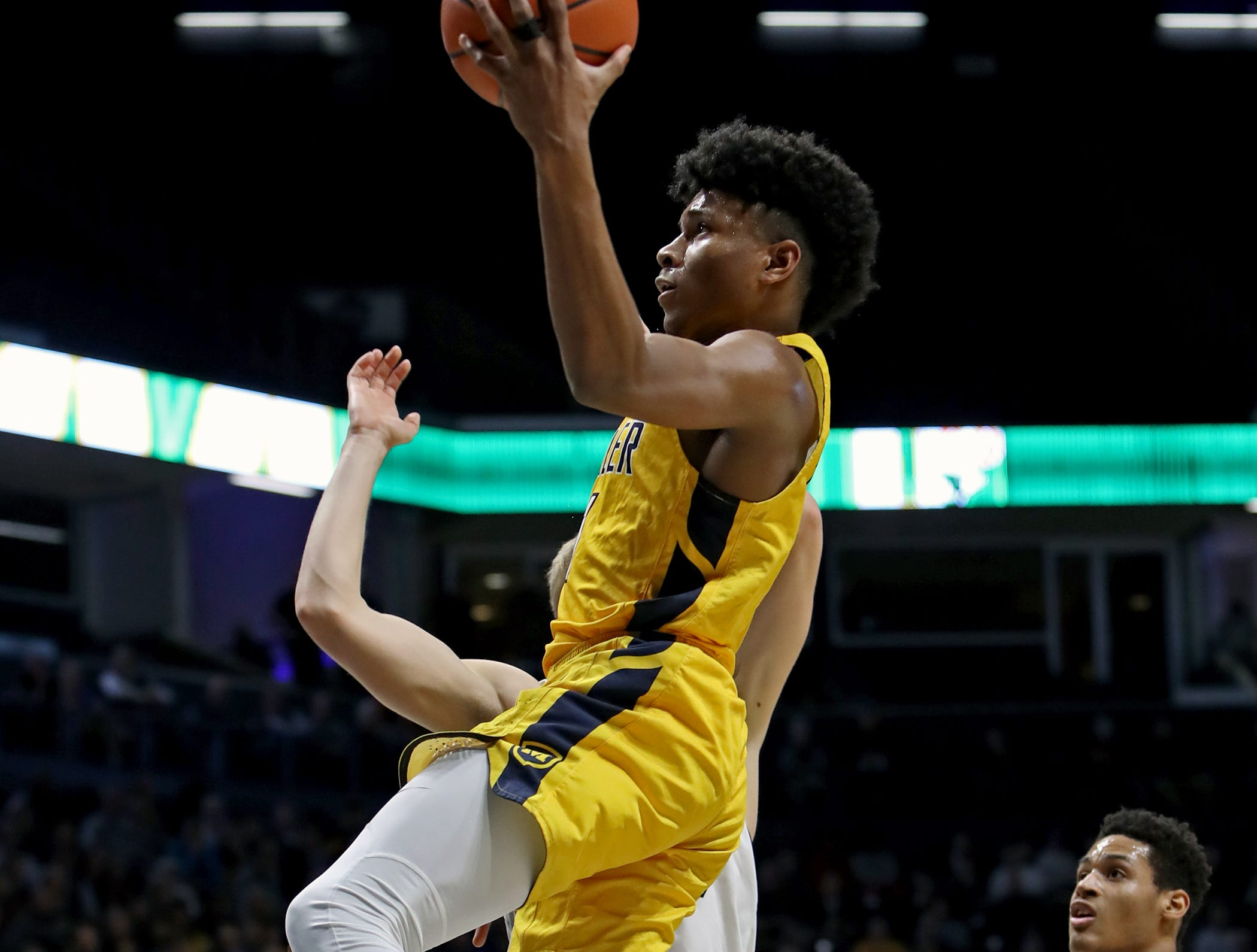Moeller guard Miles McBride drives and scores in the boys regional semifinal March 13, 2019, at Xavier University's Cintas Center. Moeller defeated Lakota East 47-33.