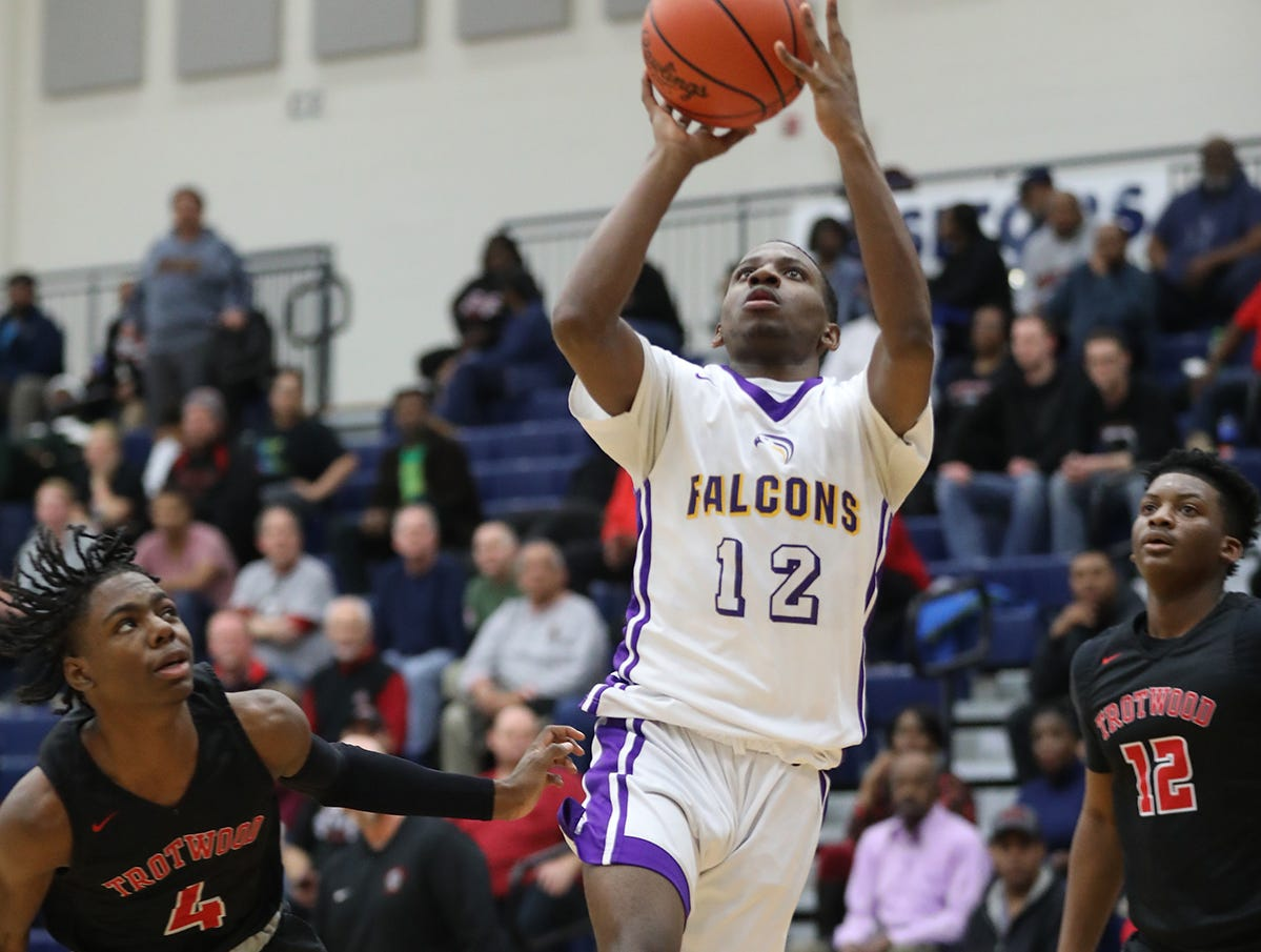 Aiken Jakada Stone drives to the basket during the Falcons regional semifinal game against Trotwood Madison, Thursday, March 14, 2019.