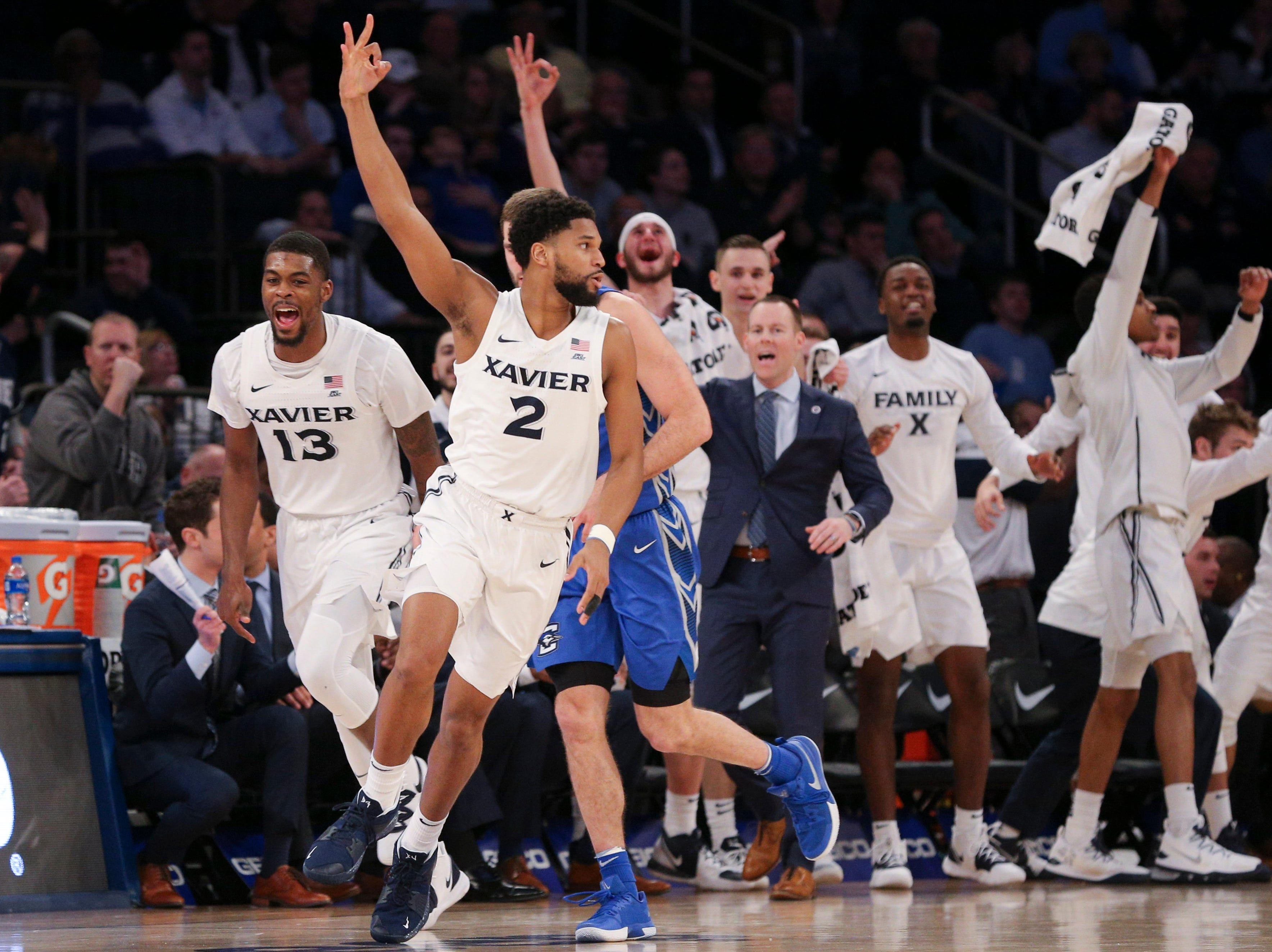 Xavier Musketeers guard Kyle Castlin (2) celebrates a three point shot against the Creighton Bluejays during the second half of a quarterfinal game of the Big East conference tournament at Madison Square Garden.
