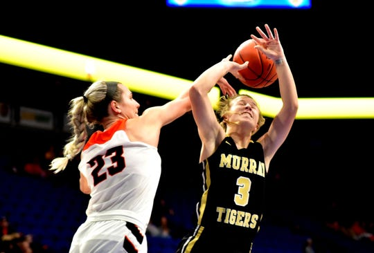 Maddie Scherr (23) of Ryle blocks the shot of Murray's Parker Greer as the Lady Raiders take game one 56-29 at the KHSAA Girls Sweet 16 at Rupp Arena, March 13, 2019.