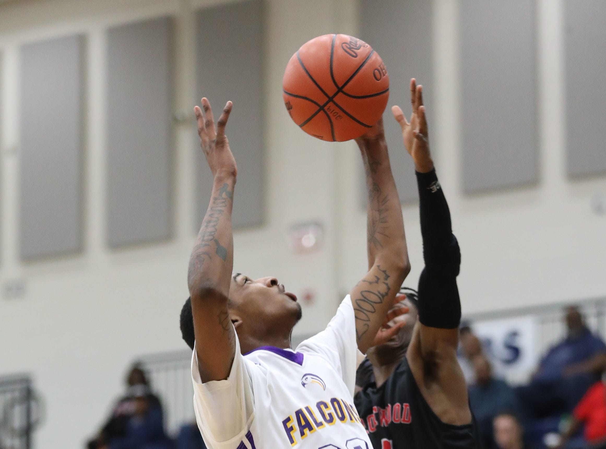 Aiken forward Tremaine Smith battles for a rebound basket during the Falcons regional semifinal game against Trotwood Madison, Thursday, March 14, 2019.