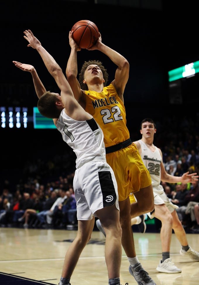 Moeller guard Max Land drives and scores in the boys regional semifinal March 13, 2019, at Xavier University's Cintas Center. Moeller defeated Lakota East 47-33.