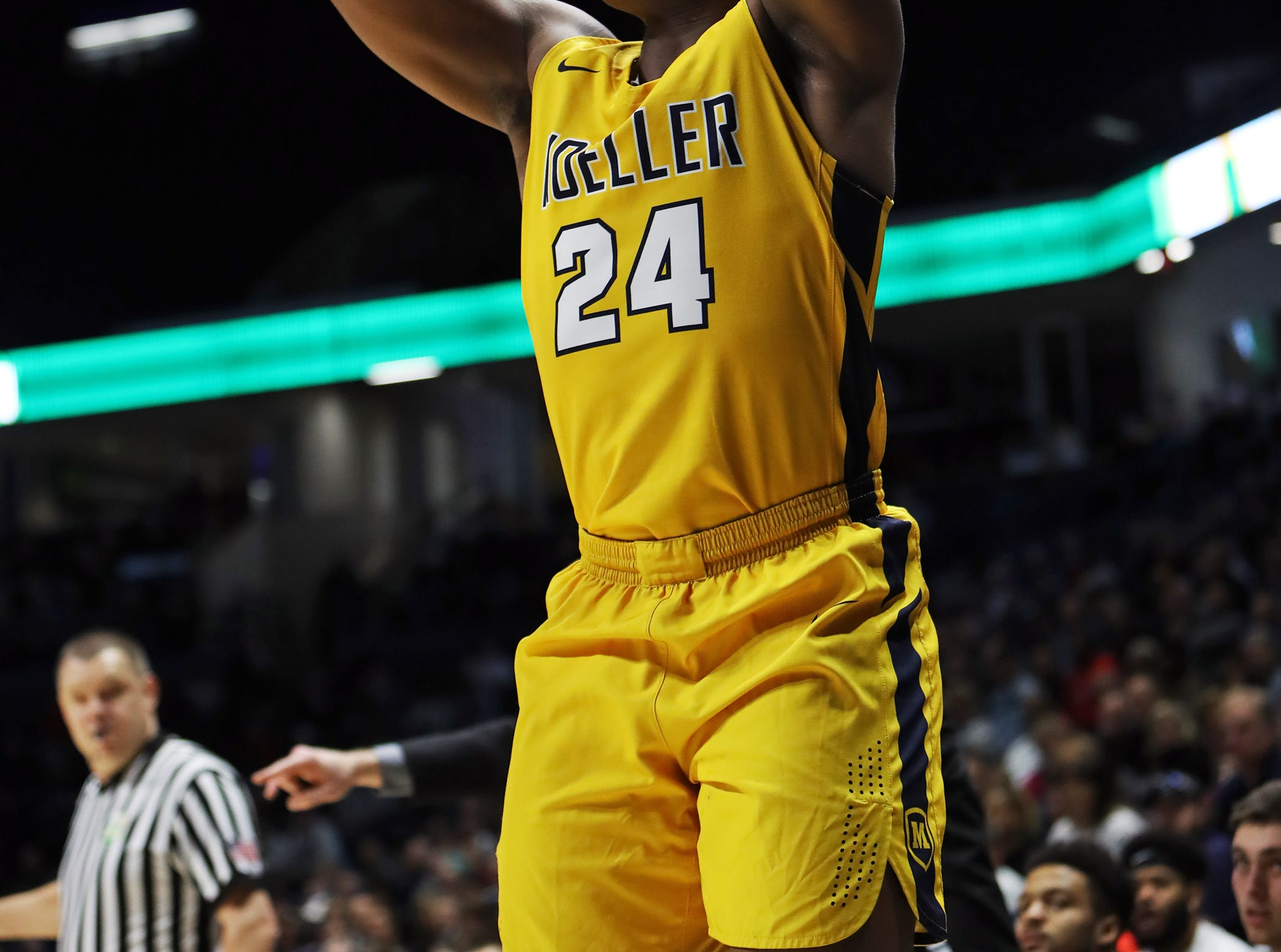 Moeller guard Alex Williams attempts a jump shot in the first half of the boys regional semifinal March 13, 2019, at Xavier University's Cintas Center. Moeller defeated Lakota East 47-33.